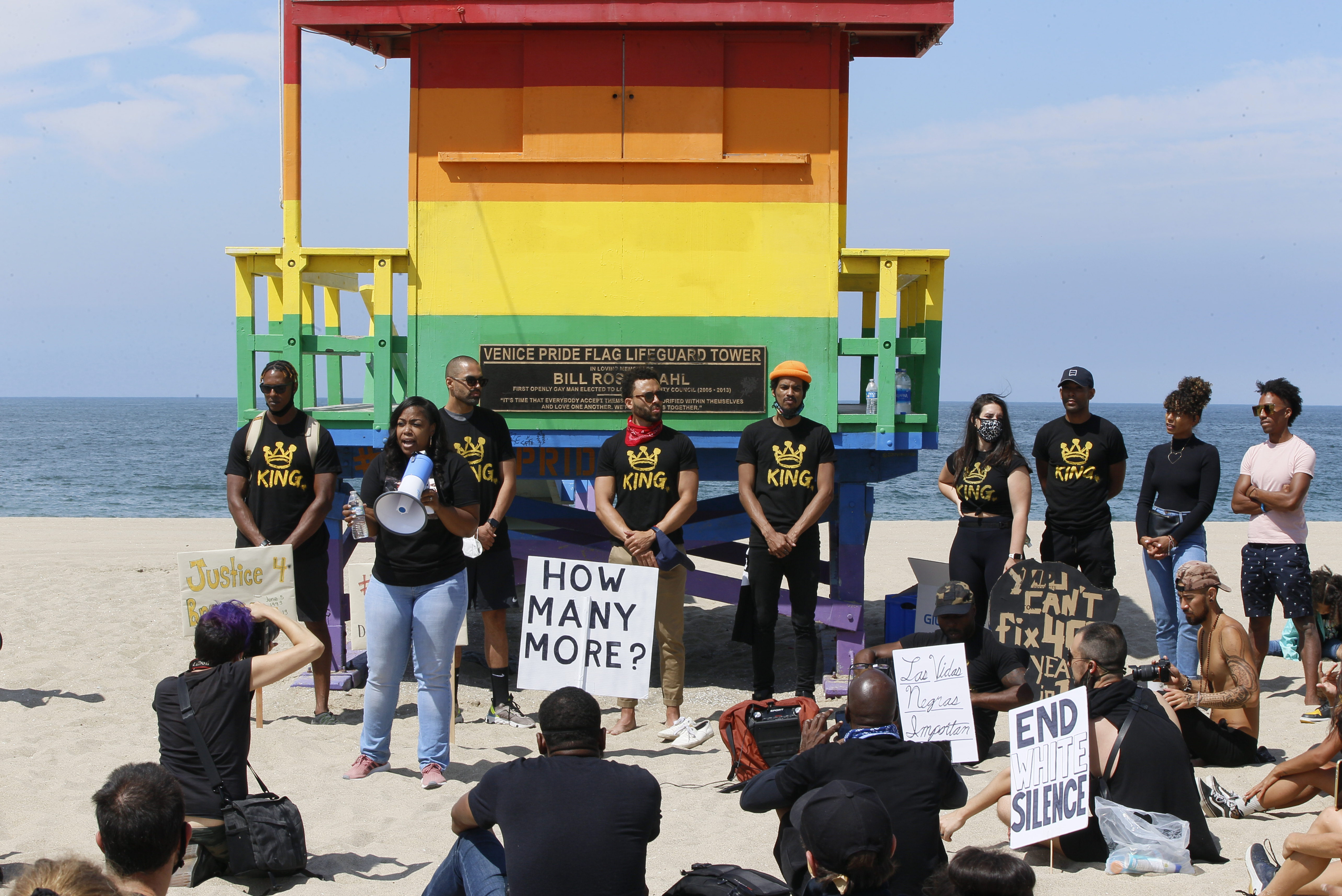 Lora King, Rodney King's daughter, left with the megaphone, holds a Black Lives Matter protest at Venice Beach on June 12.