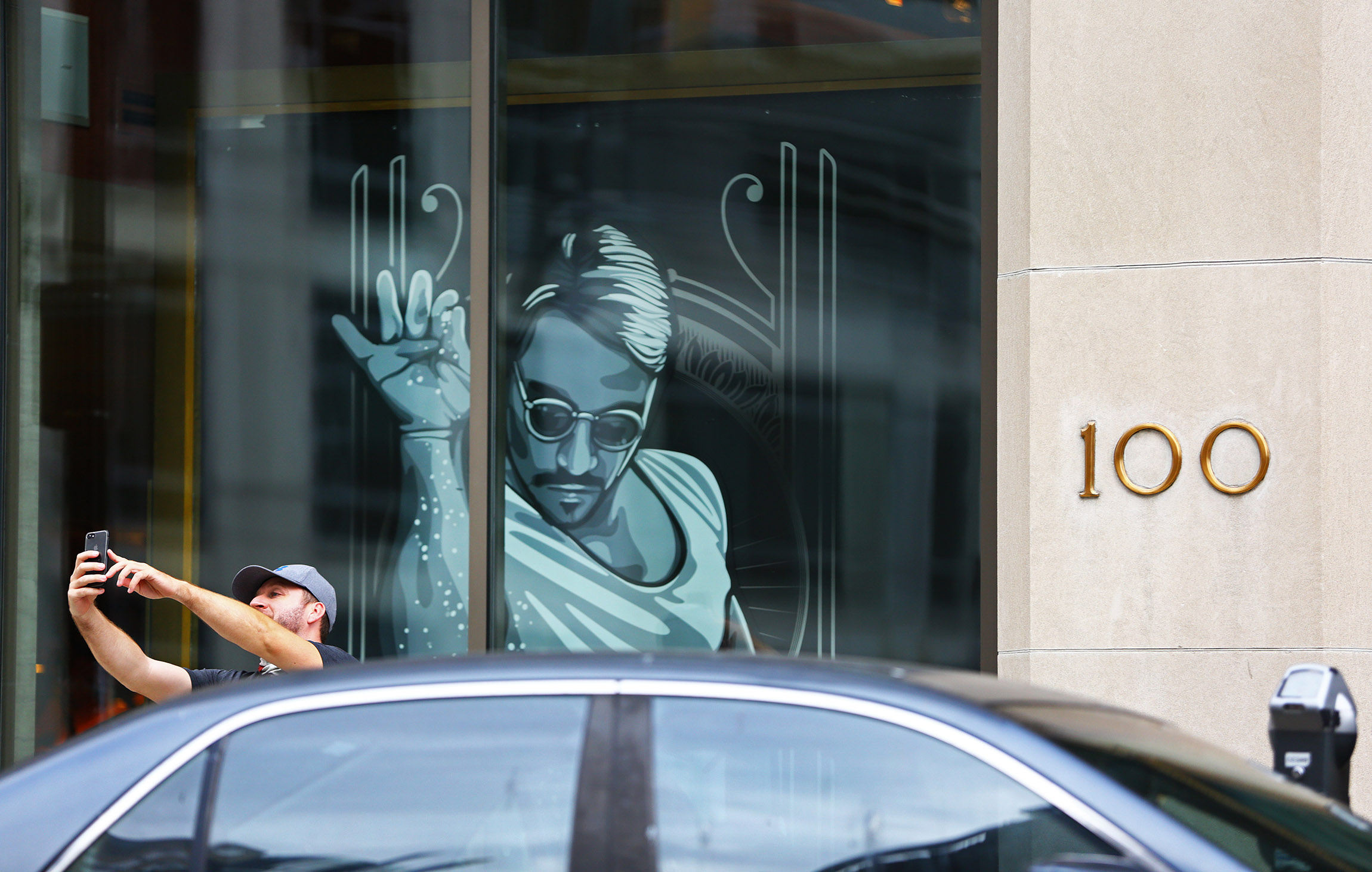An unidentified man parks and takes a selfie next to the restaurant Nusr-Et, in Boston on Sept. 27.