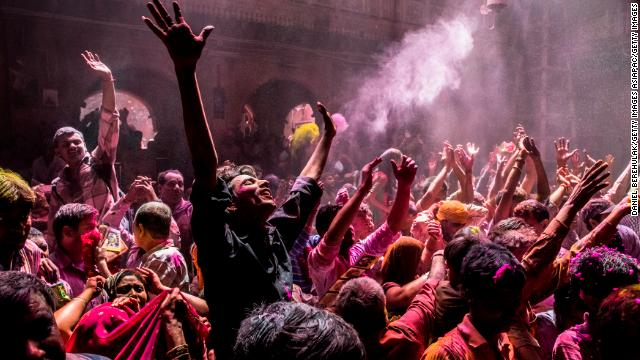 Hindu devotees play with color during Holi celebrations at the Banke Bihari temple in 2013 in Vrindavan, India.