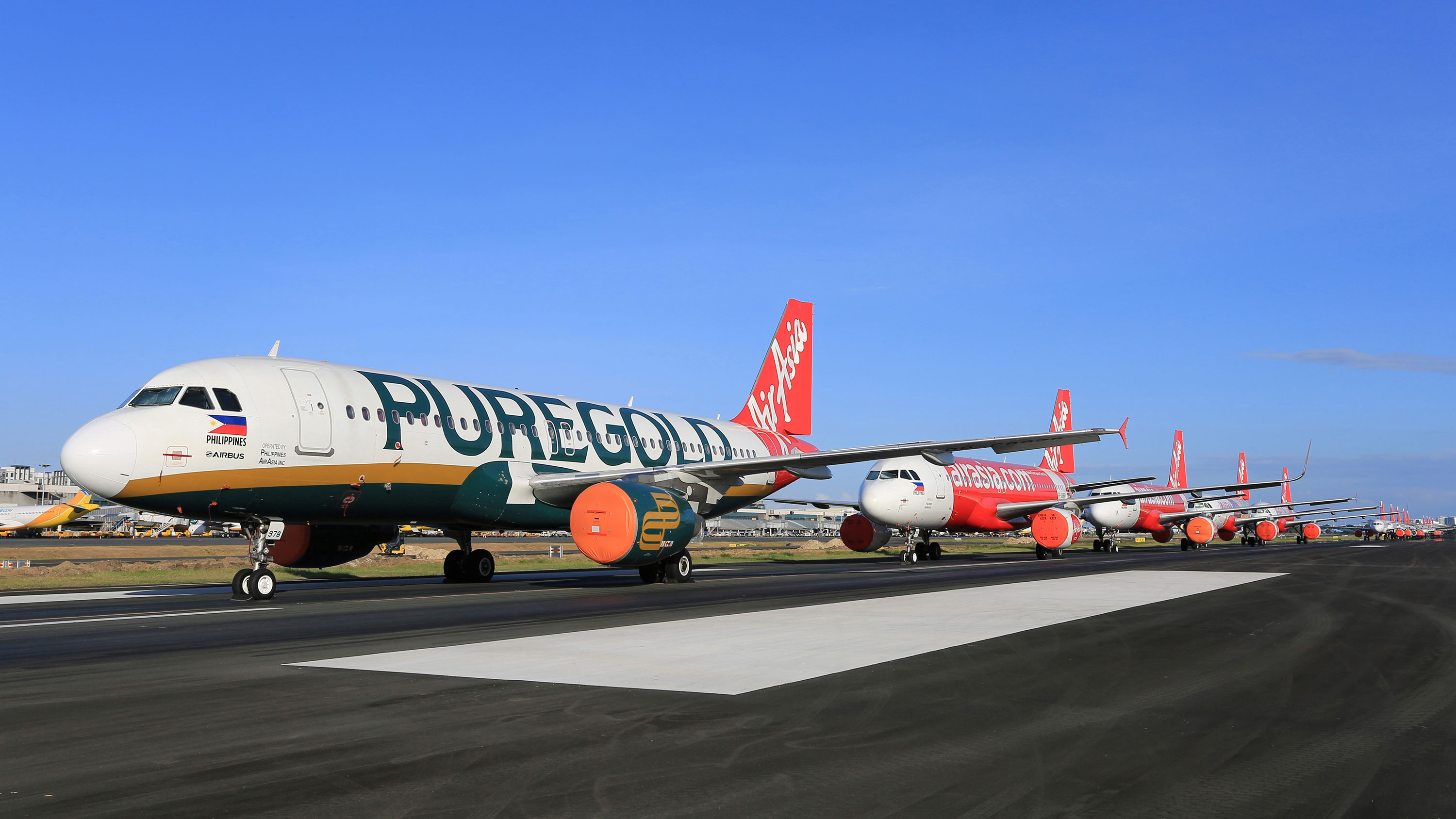 AirAsia passenger planes sit on the tarmac of Manila's international airport on April 19 in the Philippines.