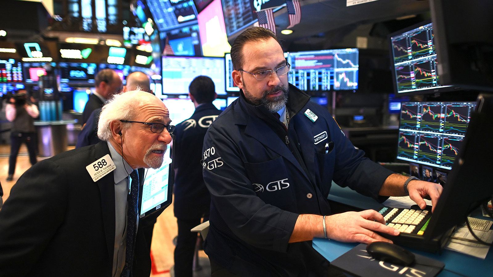 Traders work during the opening bell at the New York Stock Exchange on February 27.