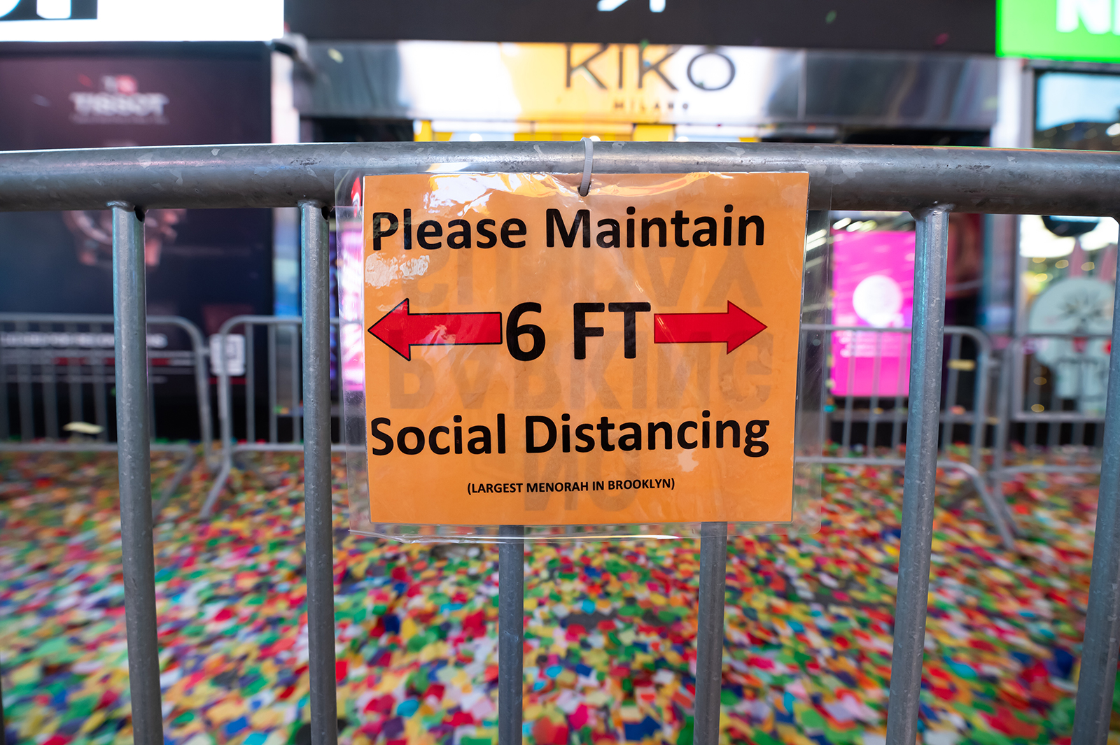 A social distancing sign is seen during the 2021 New Year's Eve celebration in Times Square New York City, on December 31, 2020.