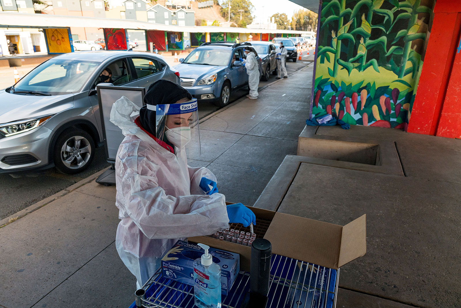 A medical worker places test tubes into a cardboard box at a drive-thru coronavirus testing site in San Francisco, California, on November 19.