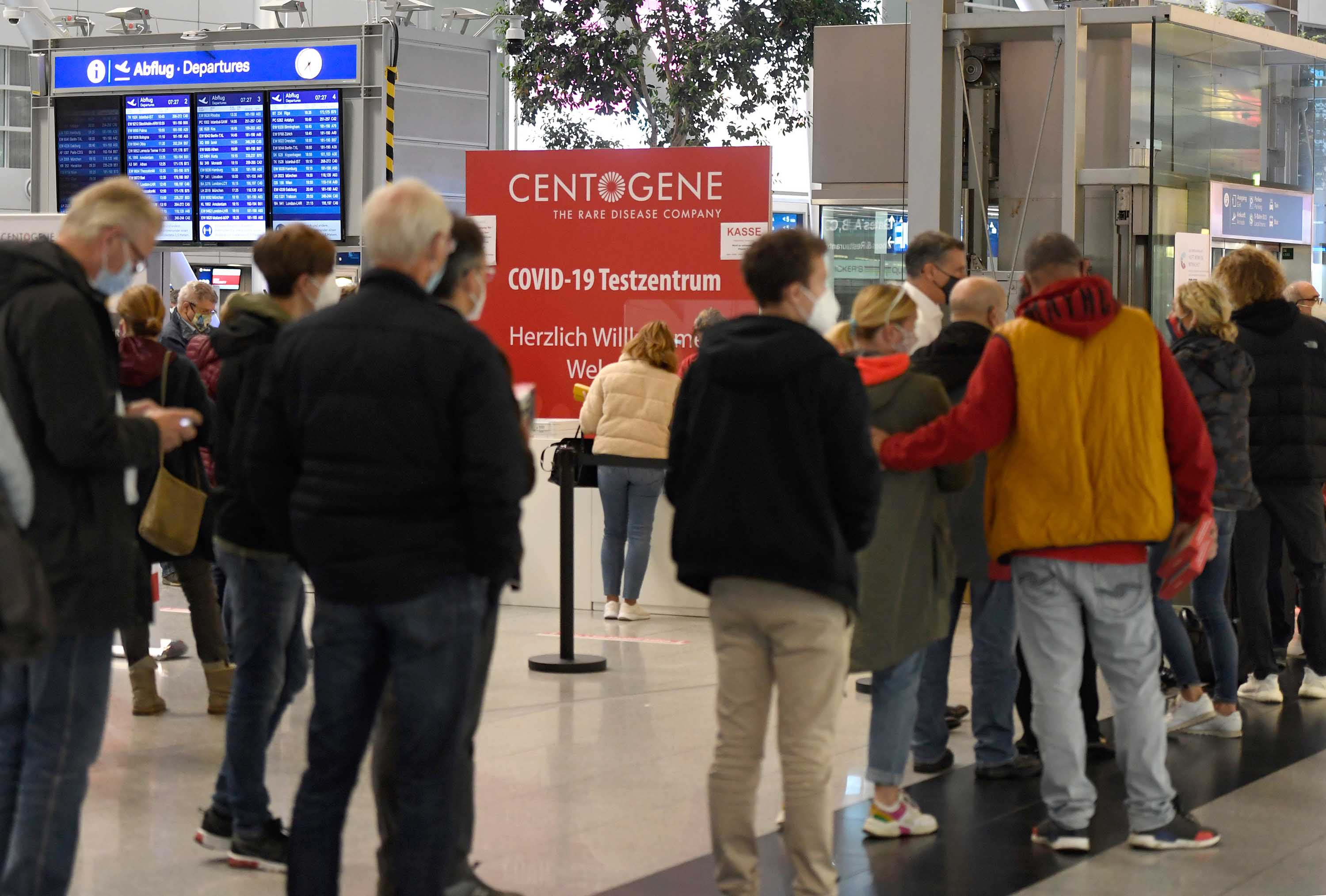 Travelers queue to take coronavirus tests at Duesseldorf airport in Germany on October 13.