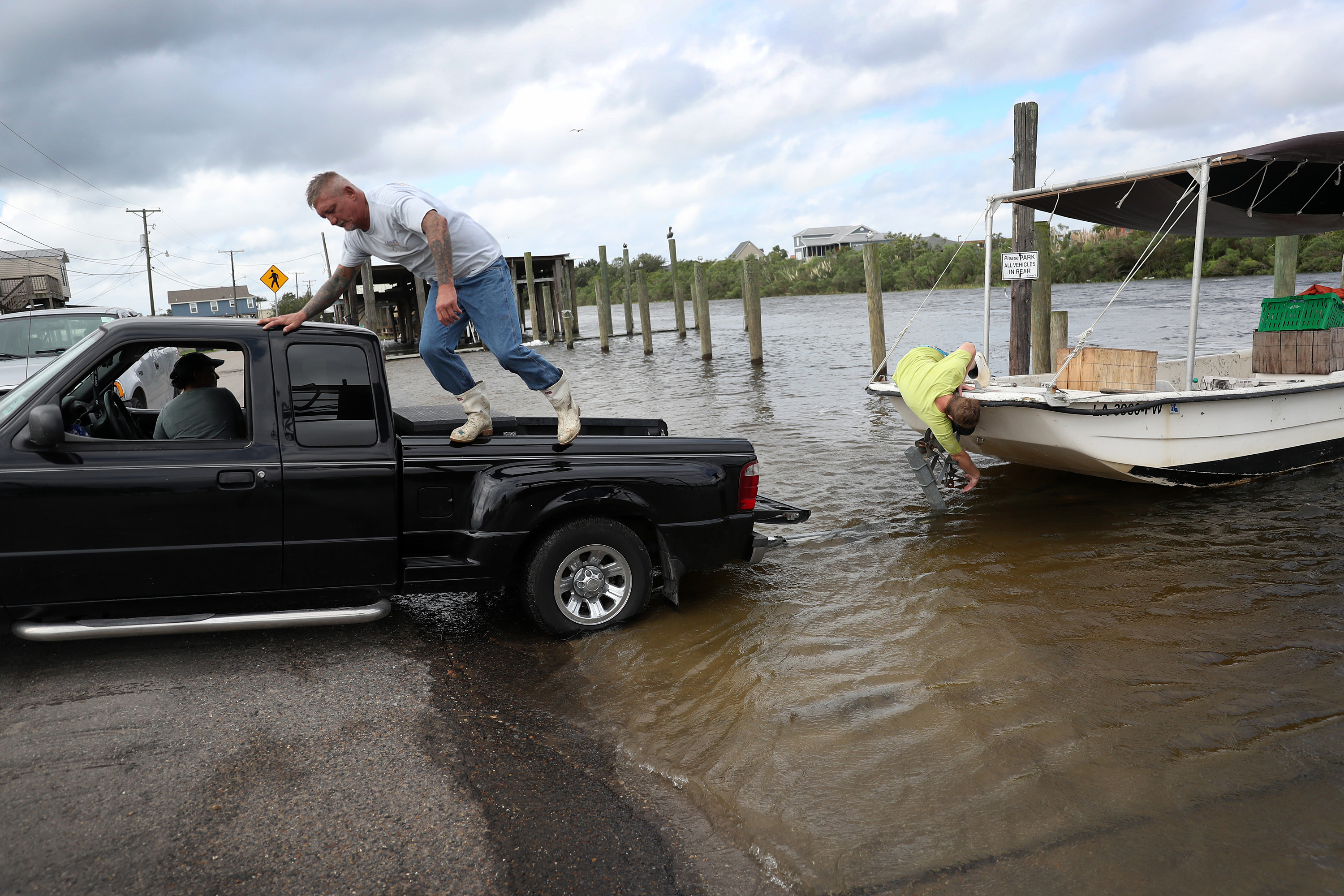People take a boat out of the water on September 14 in Shell Beach, Louisiana, before the possible arrival of Hurricane Sally.