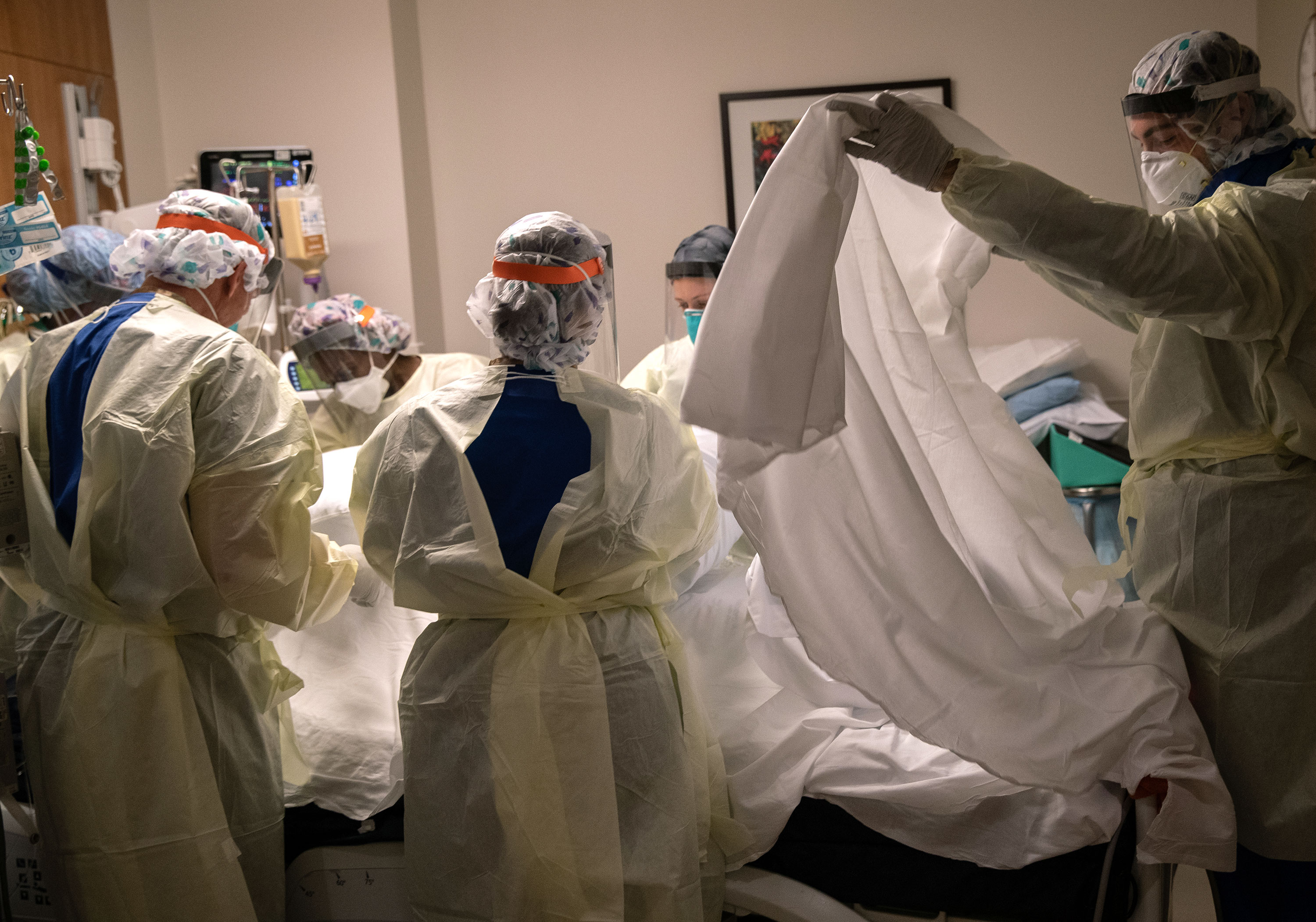 A team of health workers tend to a coronavirus patient in a Stamford Hospital intensive care unit on April 24 in Stamford, Connecticut.