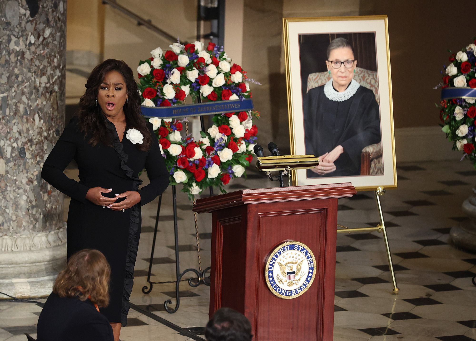 Denyce Graves sings as U.S. Supreme Court Associate Justice Ruth Bader Ginsburg's flag-draped casket rests on the Lincoln catafalque in Statuary Hall as she lies in state at the U.S. Capitol on September 25 in Washington, DC.