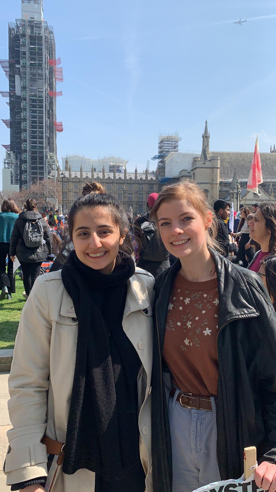 Niki Shahab (left) and Imogen Gaskell (right) protest in front of Britain's Houses of Parliament.