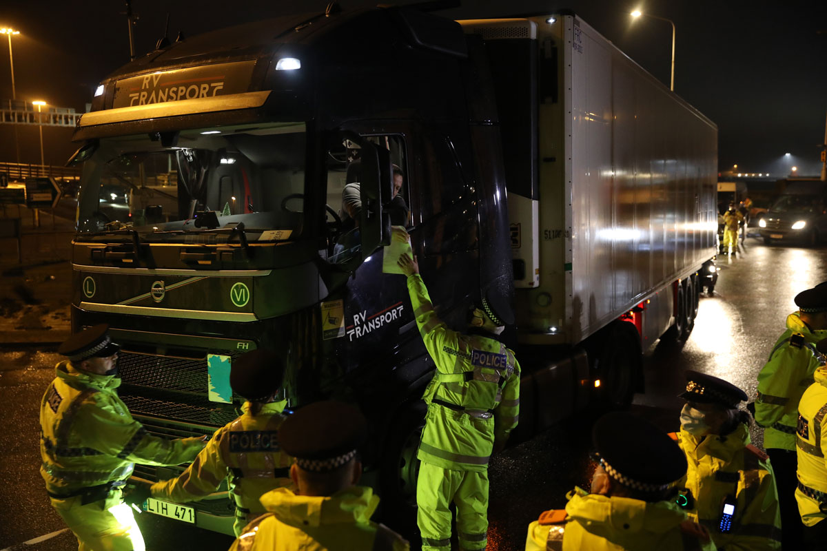 Police officers direct lorry drivers at the Port of Dover on December 23 in Dover, United Kingdom.