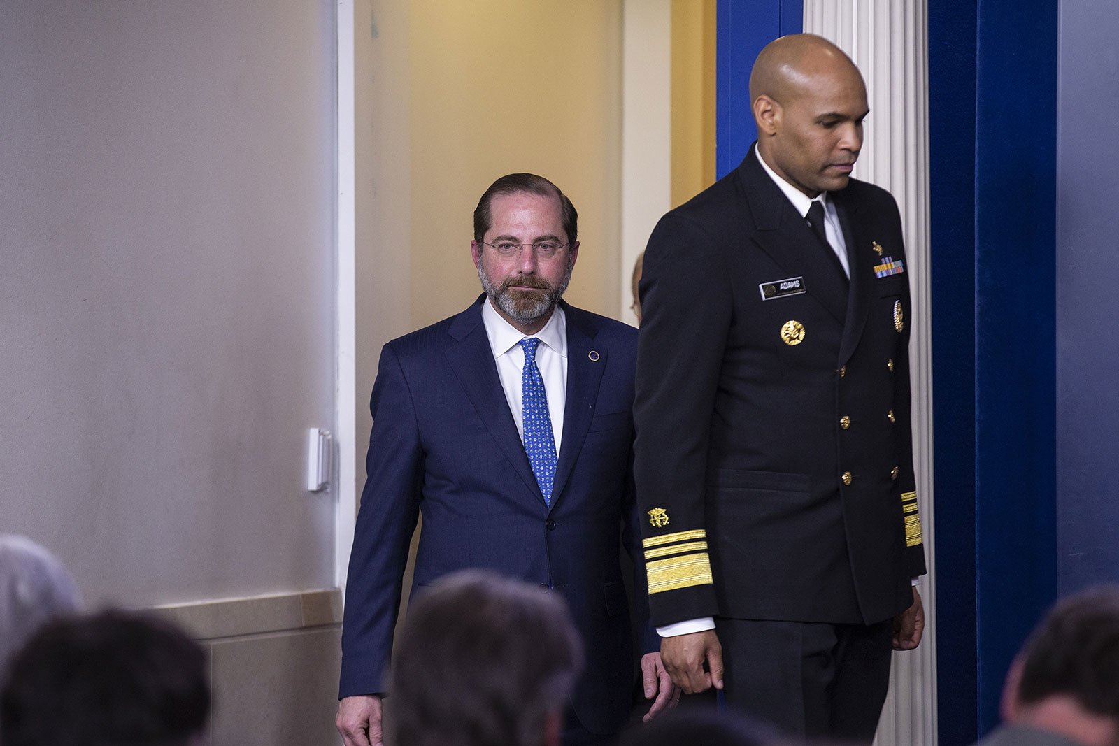 From left, Health and Human Services Secretary Alex Azar and US Surgeon General Jerome Adams arrive at a coronavirus task force briefing on March 9.