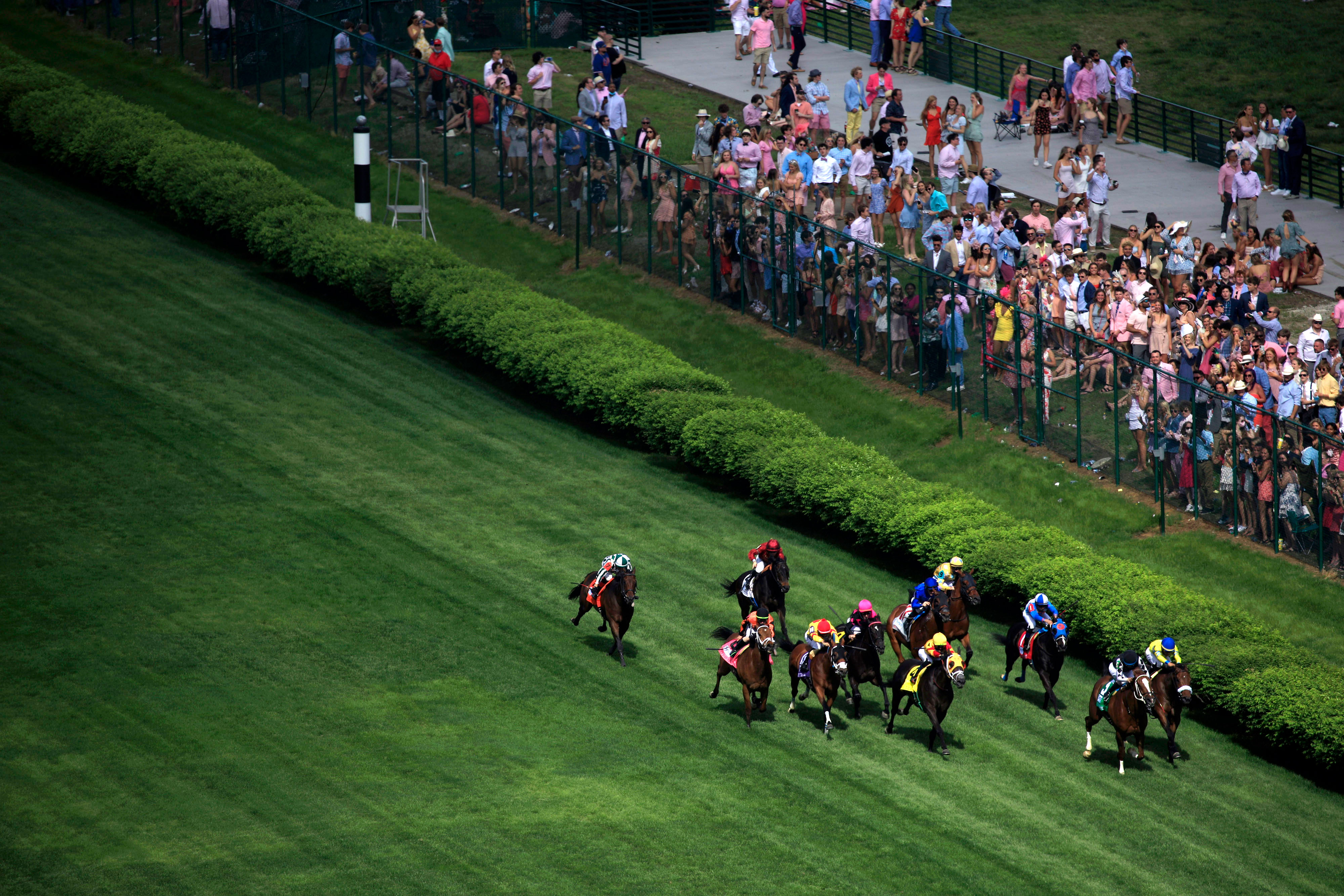 Thoroughbred racehorses compete in a turf race at Churchill Downs on April 30 ahead of the Kentucky Derby in Louisville.