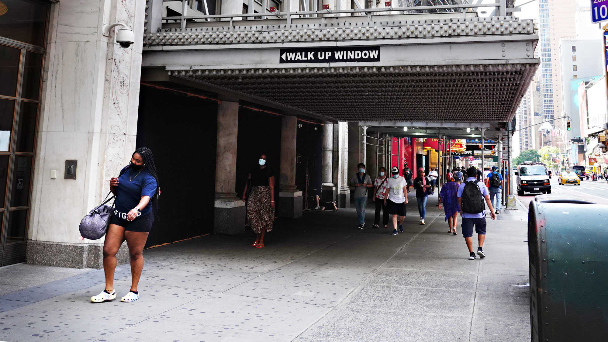 People walk in New York City on August 21.