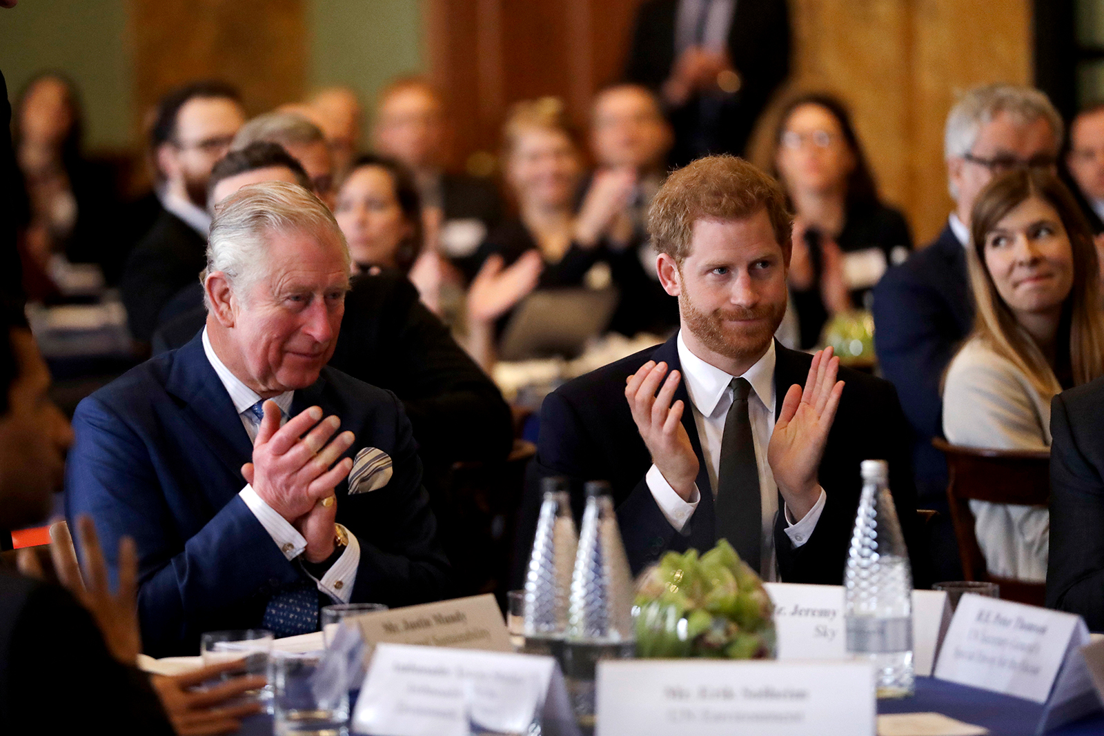 Prince Harry and Prince Charles, Prince of Wales applaud while attending the 'International Year of The Reef' 2018 meeting at Fishmongers Hall on February 14, 2018 in London, England.