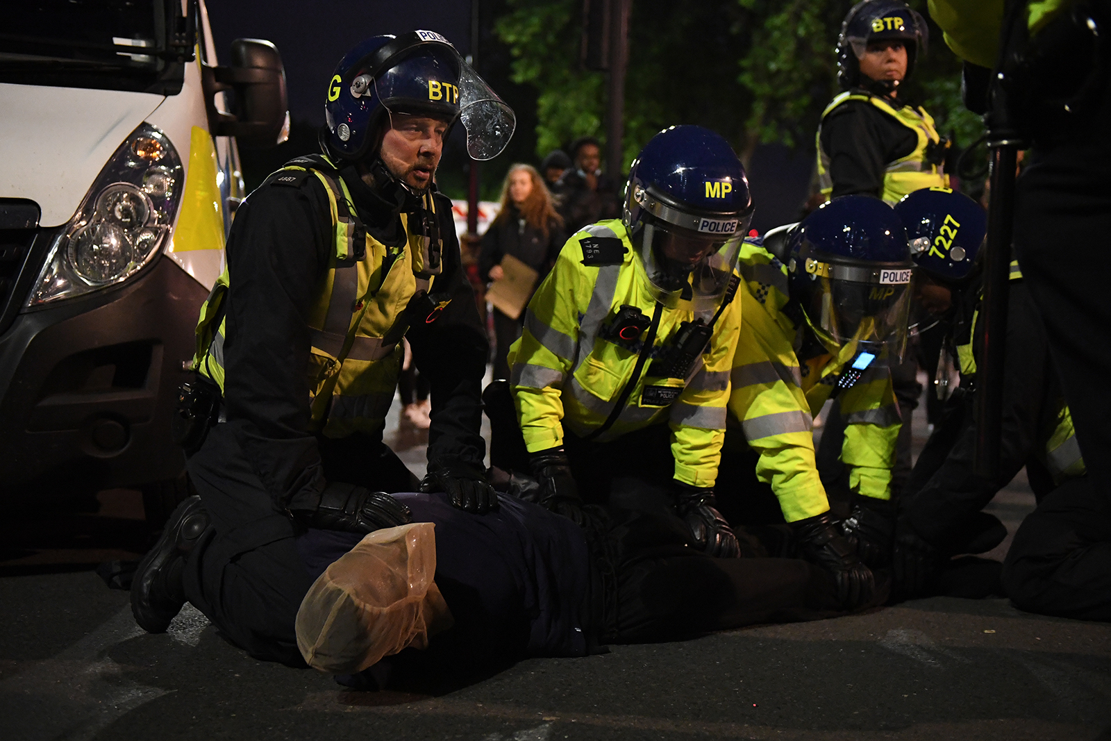 A protester is placed in a spit hood as he is restrained by officers during a Black Lives Matter protest on June 7, in London.