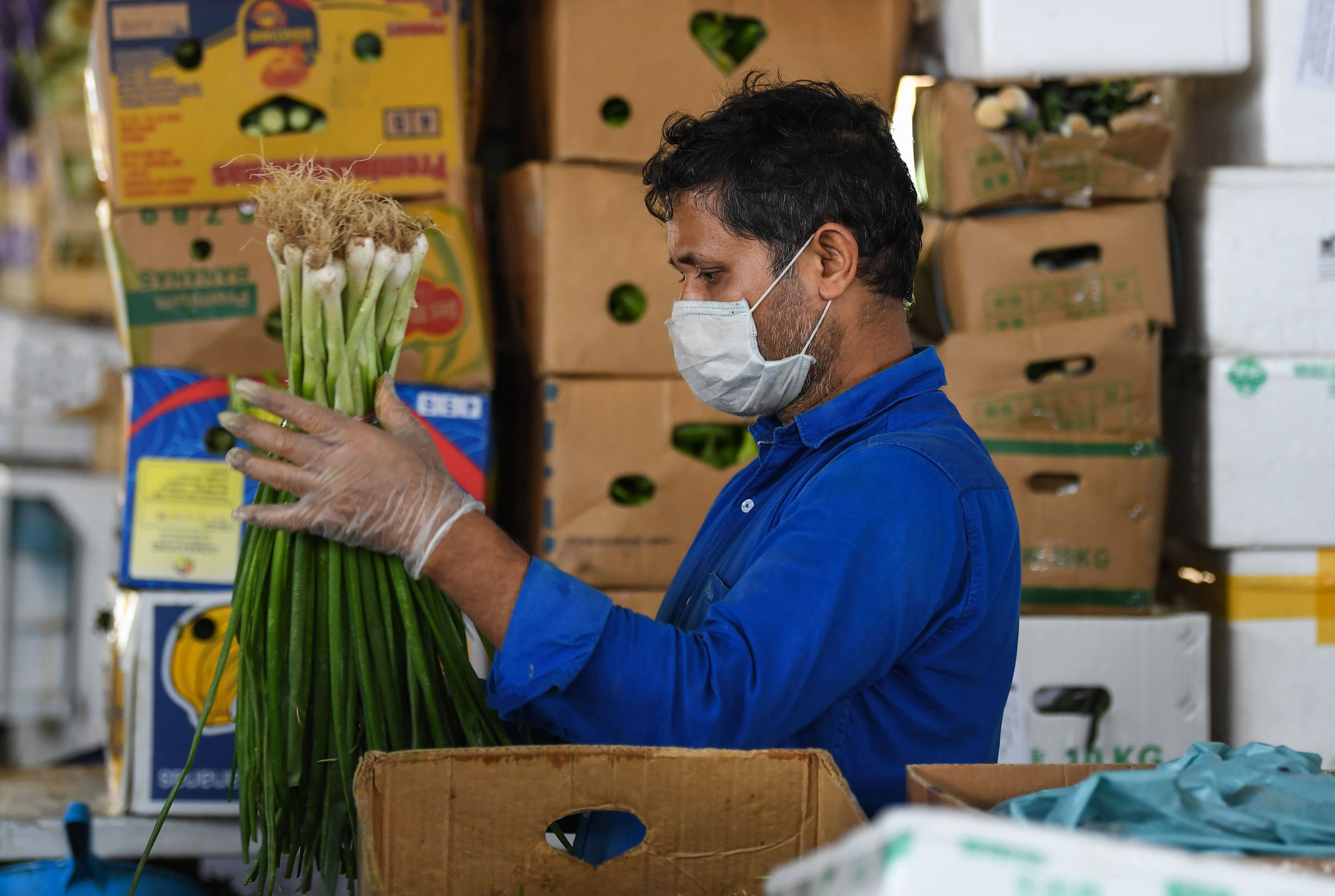 A worker sorts produce at a market in Dubai on March 21.
