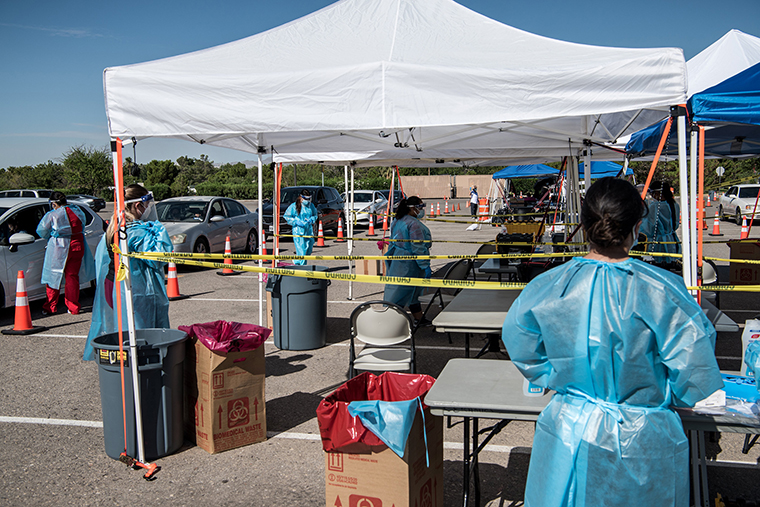 Nurses conduct coronavirus testing at a newly opened drive-thru site at El Paso Community College Valle Verde campus on July 21, in El Paso, Texas.