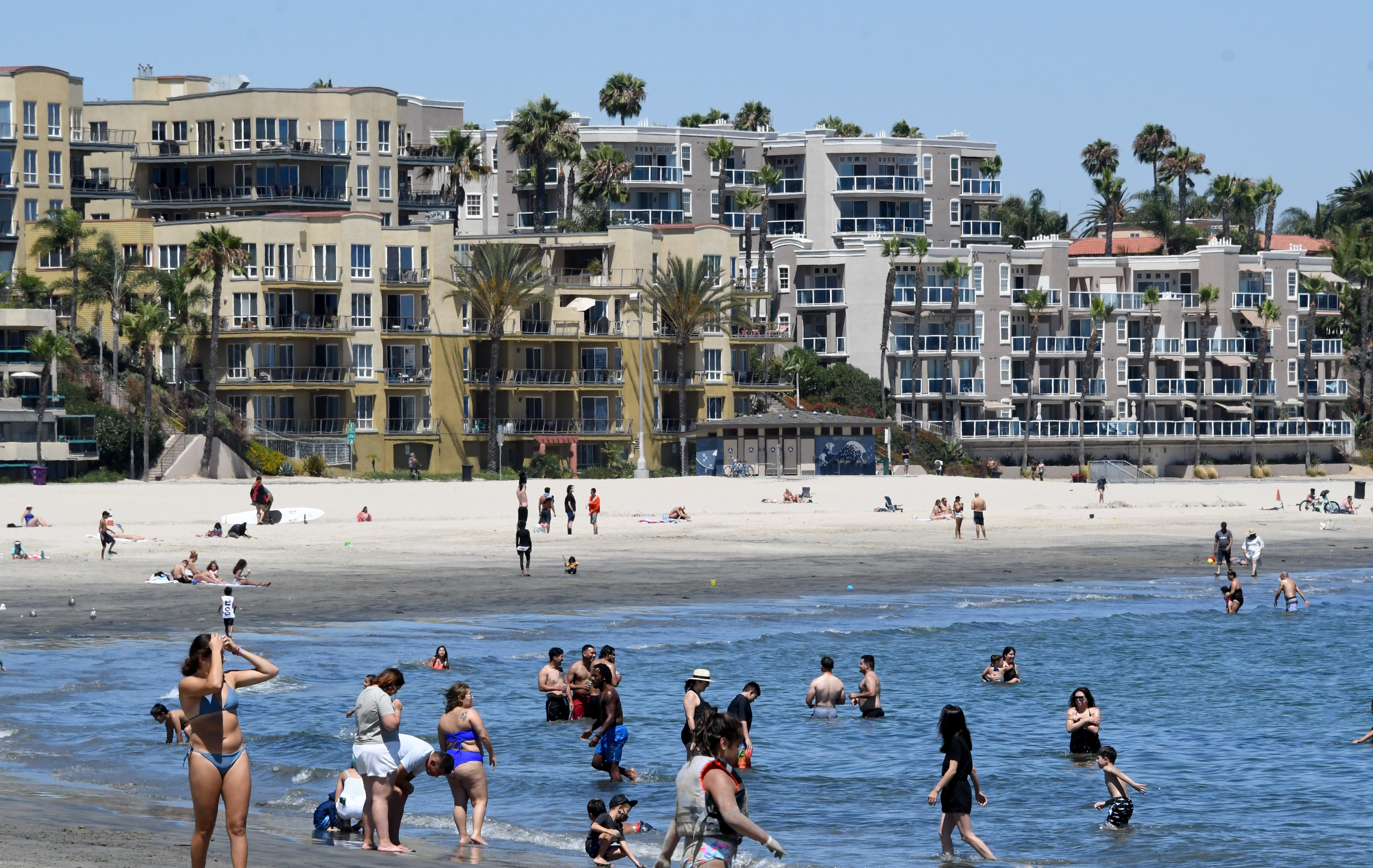 People visit Alamitos Beach in Long Beach, California, on July 18.