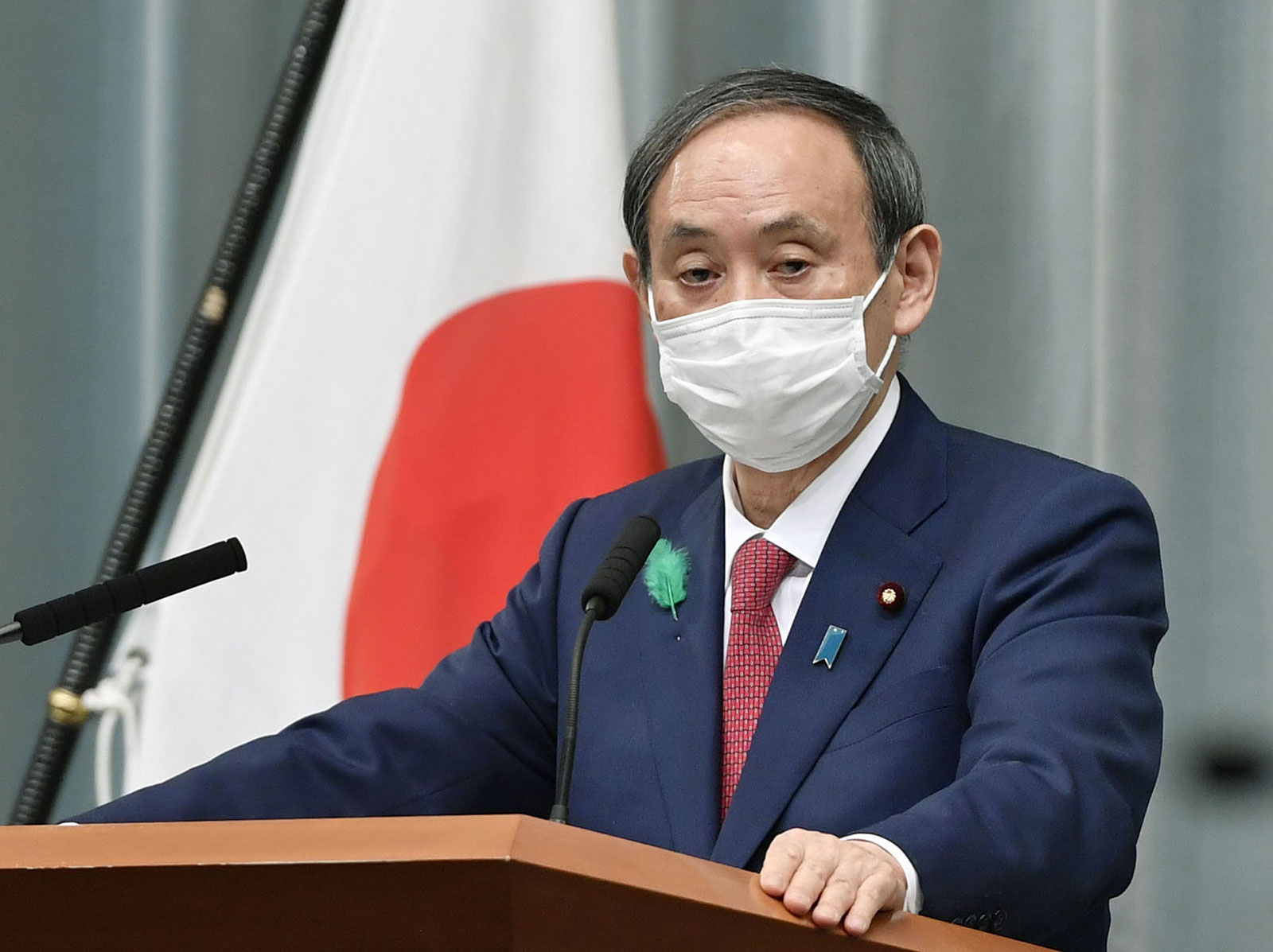Japanese Chief Cabinet Secretary Yoshihide Suga at a news conference in Tokyo on April 21.