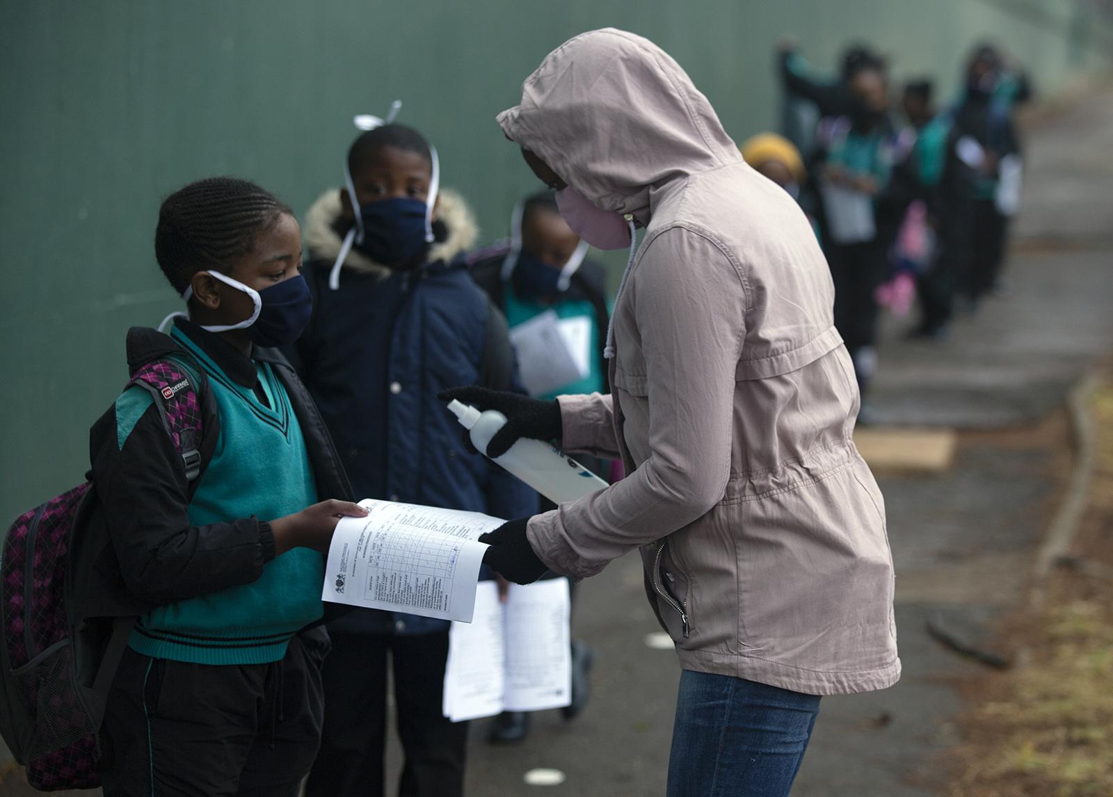 Learners go through the regular morning checks on their arrival at the Melpark Primary School in Johannesburg on Thursday, September 3.
