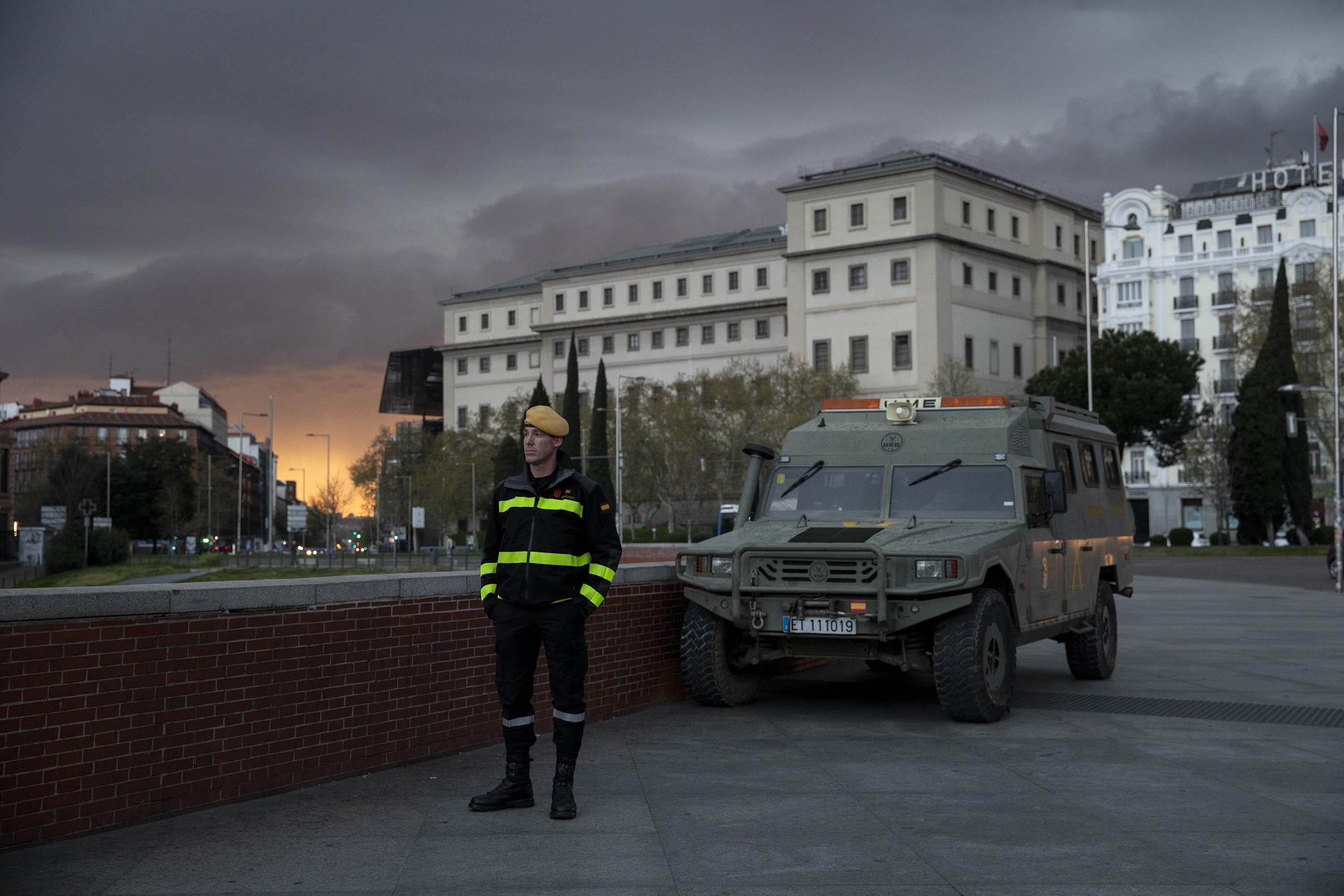 A member of Spanish Military Emergency Unit (UME) stands guard outside a train station in Madrid, Spain, on March 15.