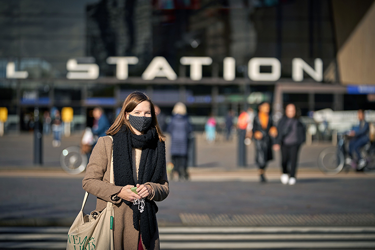 A woman looks on in front of Rotterdam's Central station in the Netherlands on November 4.