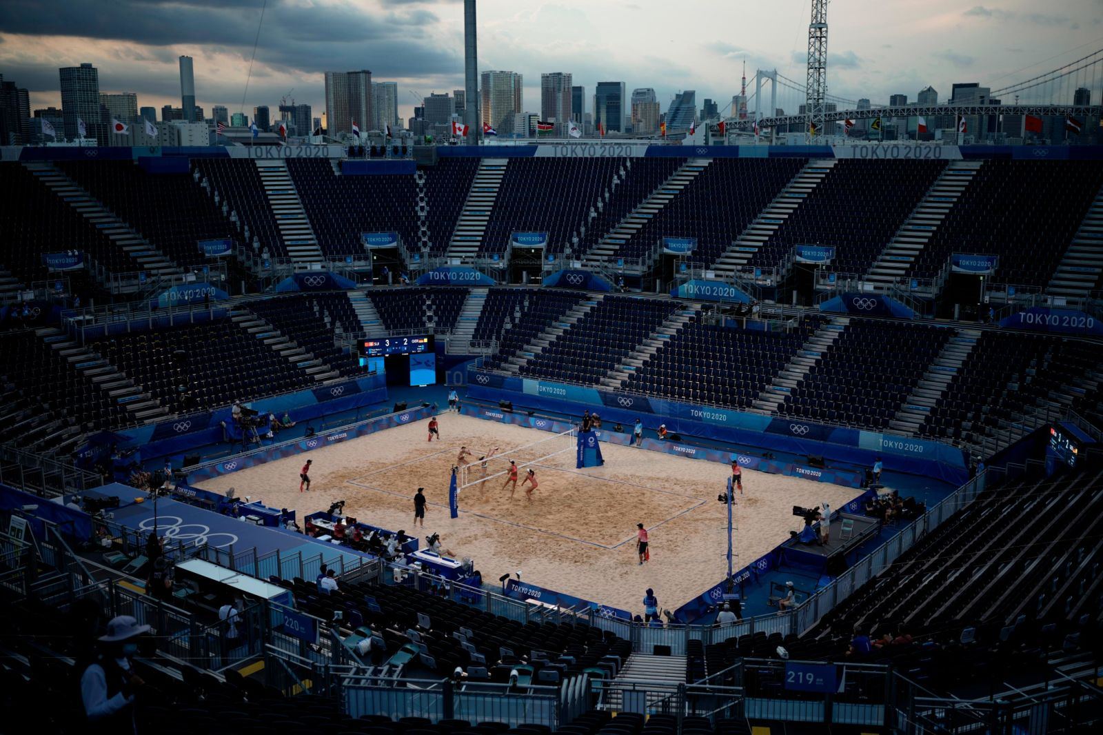 Germany's Julia Sude and Karla Borger play against Switzerland's Anouk Verge-Depre and Joana Heidrich during a women's beach volleyball match in an empty Shiokaze Park on July 24.