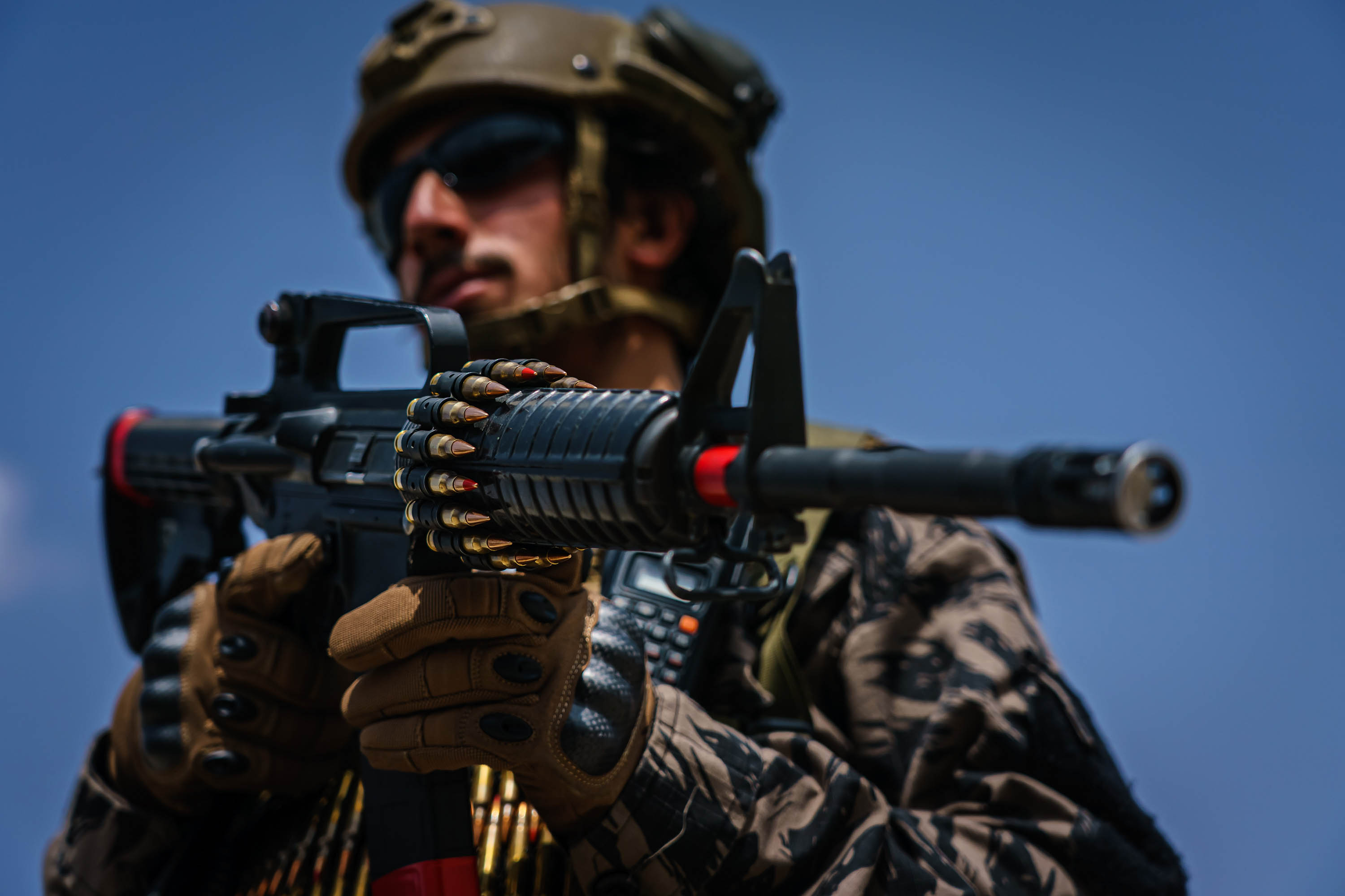 A Taliban fighter stands ready as the group takes control of the Hamid Karzai International Airport on Tuesday, August 31, in the wake of the American forces' withdrawal from Afghanistan.