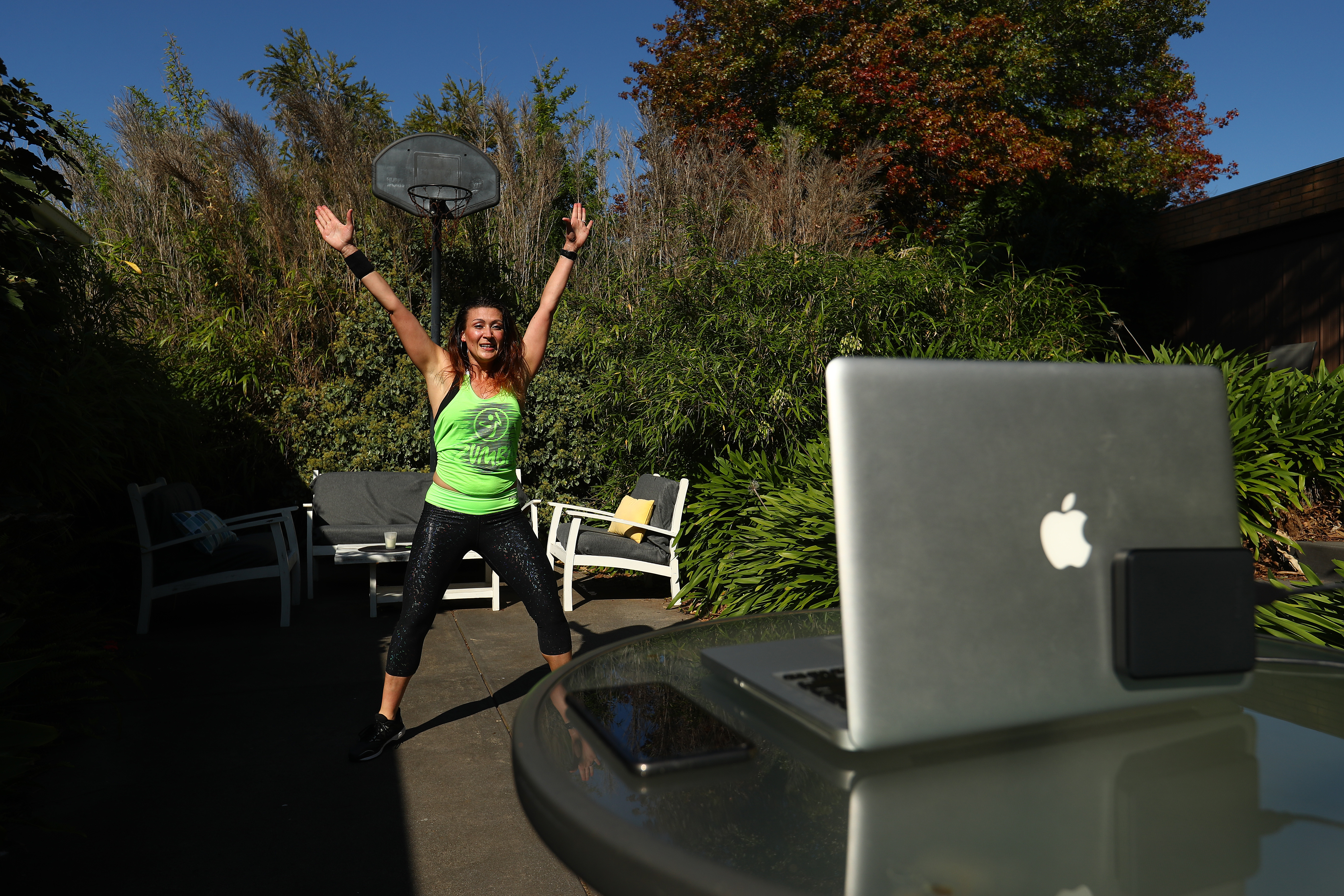 Zumba instructor Julia Basa leads an online session from her backyard in Melbourne, Australia, on April 9.