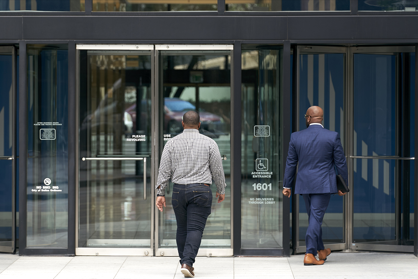 People enter an office building in downtown Dallas, Texas, on May 27.