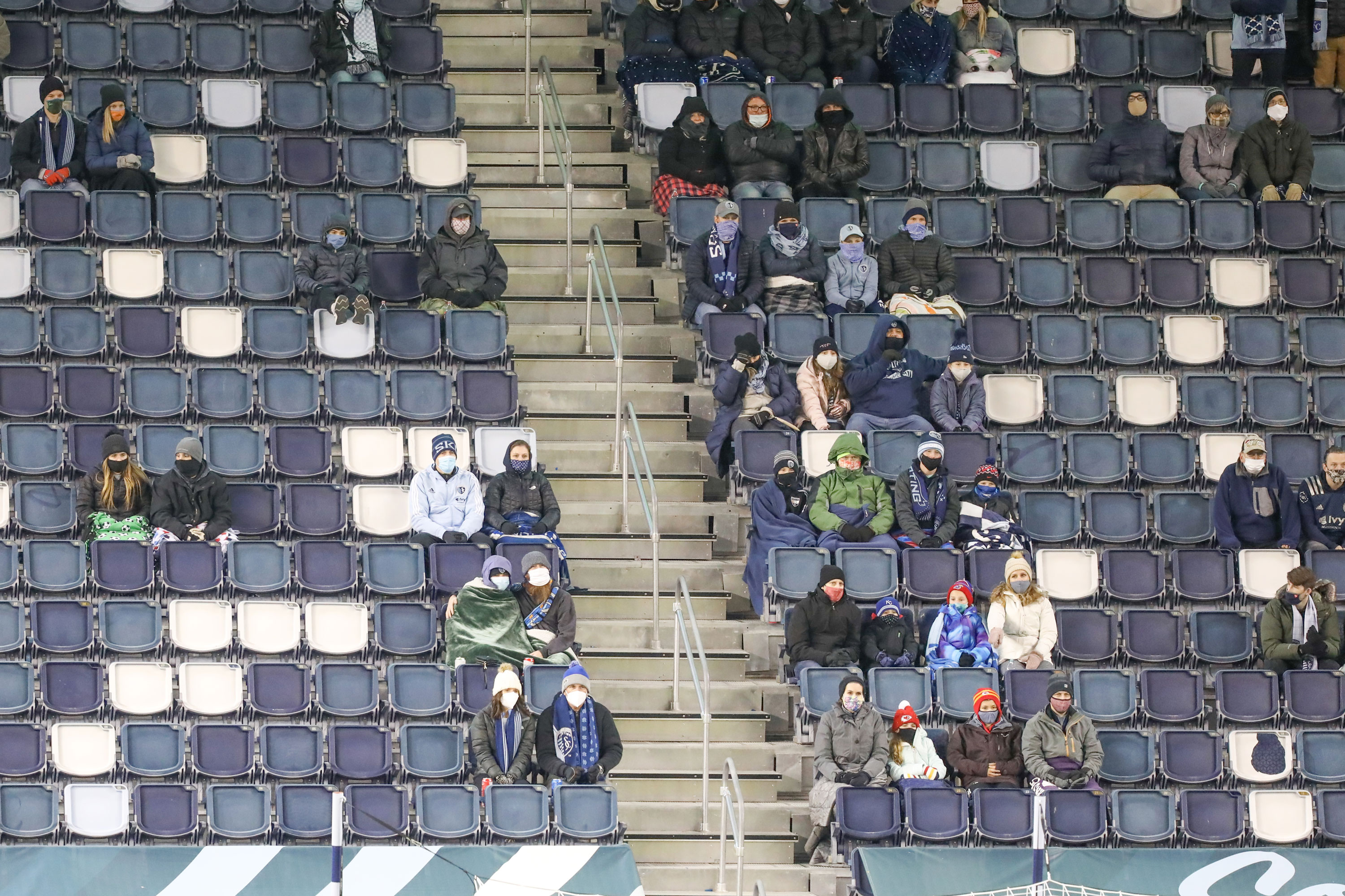 Fans try to stay warm while also wearing masks and social distancing in the first half of an MLS match between the Colorado Rapids and Sporting Kansas City on October 24 at Children's Mercy Park in Kansas City, KS.