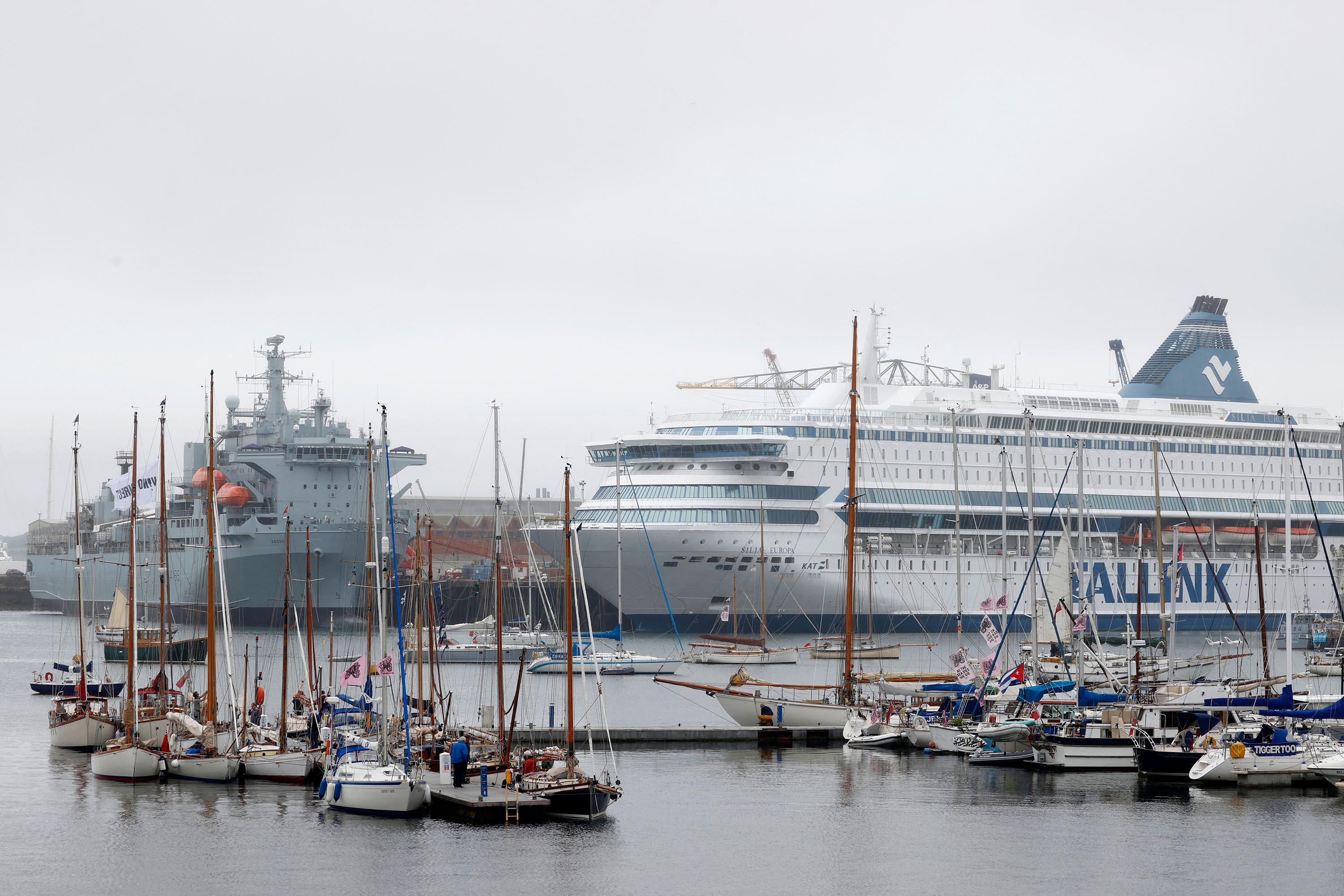 The MS Silja Europa, (R), which is housing police officers, is berthed in the harbor at Falmouth, Cornwall on June 10.