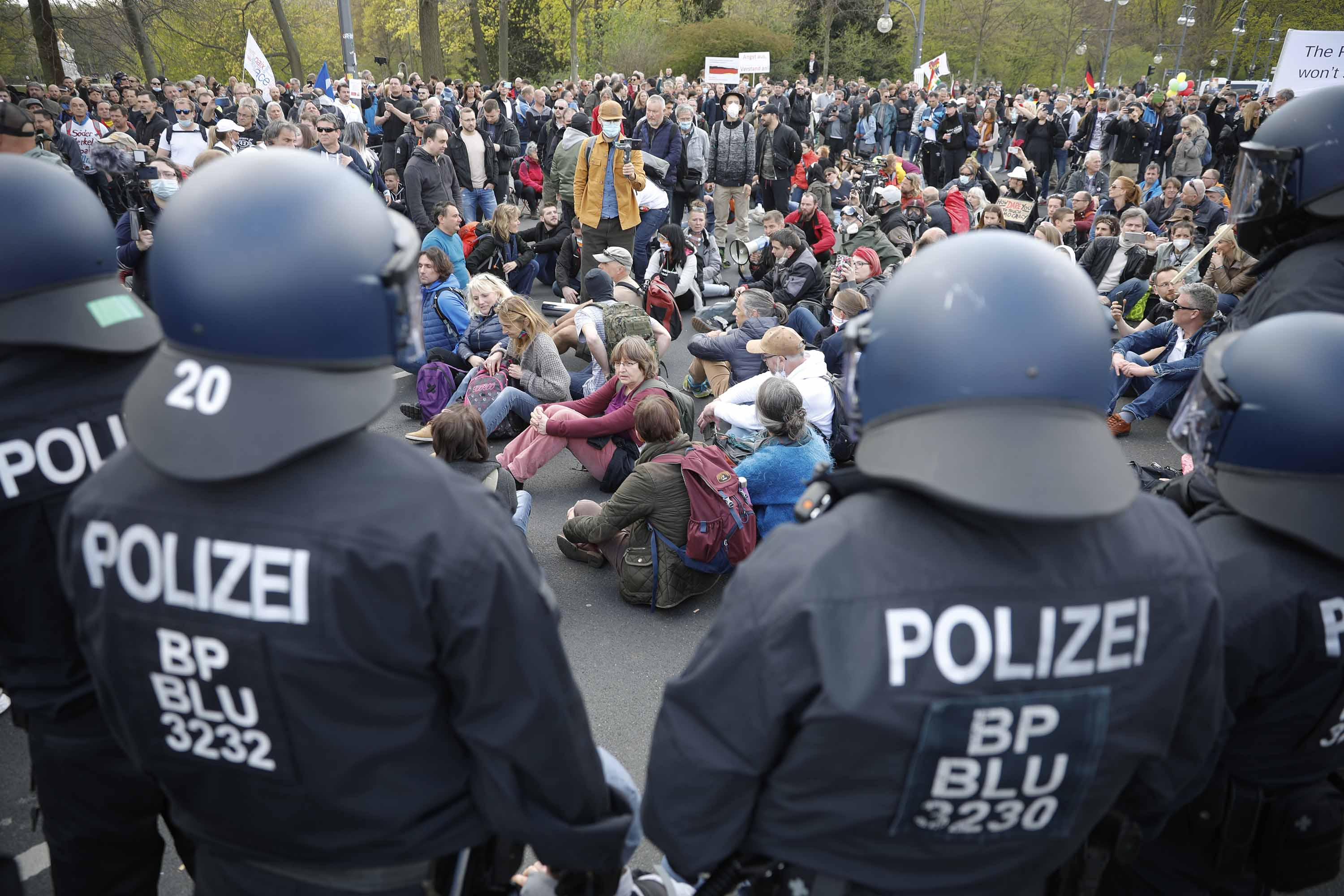 Demonstrators rally against the German government's proposed coronavirus measures in Berlin, on Wednesday, April 21.