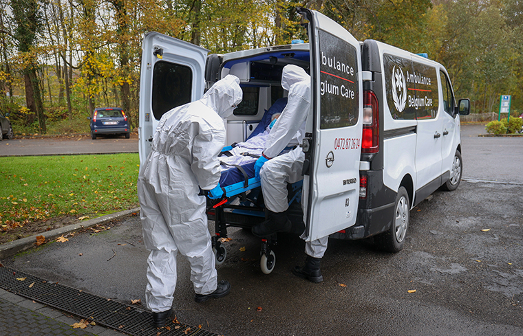 A patient arrives from a hospital at a recovery center in Spa, Belgium, on November 3.
