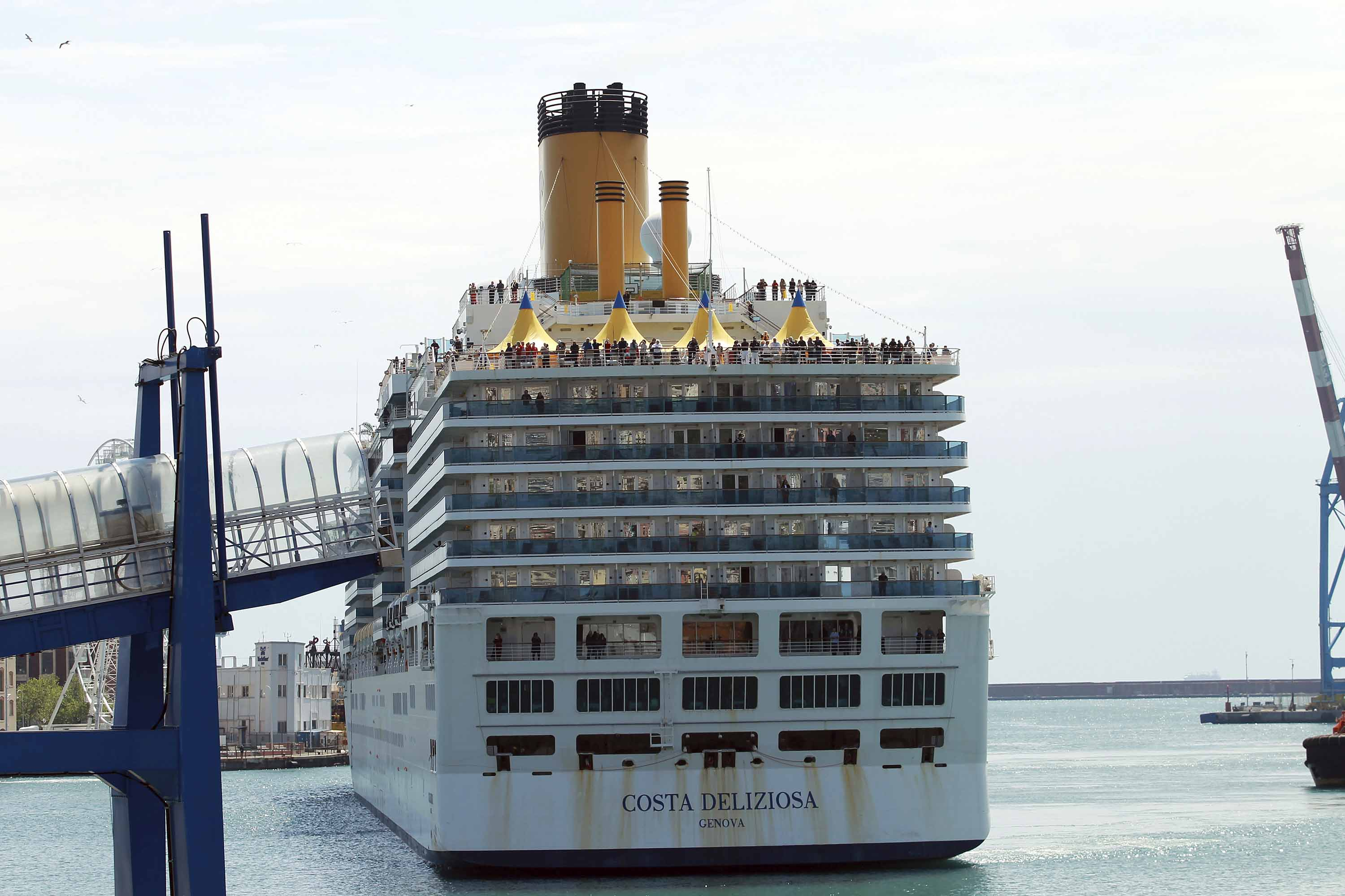 The Costa Deliziosa cruise ship docks in the port of Genoa, Italy, on Wednesday.