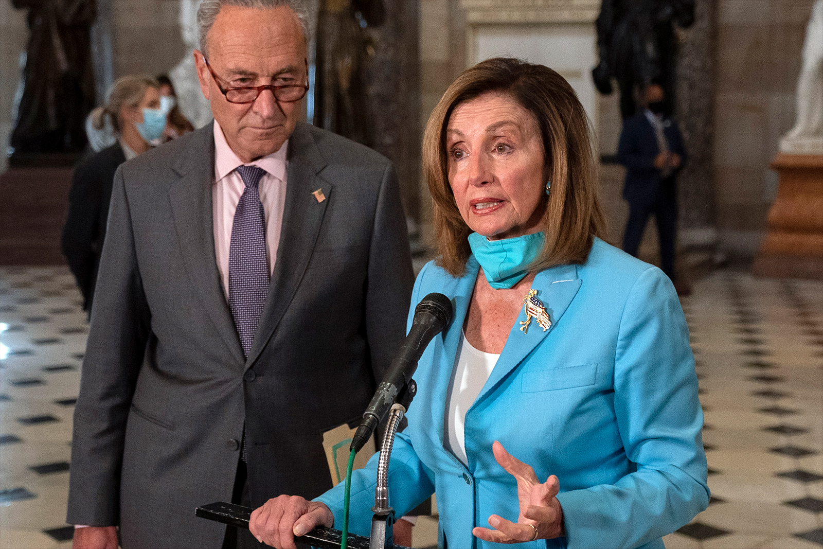 House Speaker Nancy Pelosi of Calif., joined by Senate Minority Leader Sen. Chuck Schumer of N.Y., speaks to media on Capitol Hill in Washington, on Wednesday, August 5.