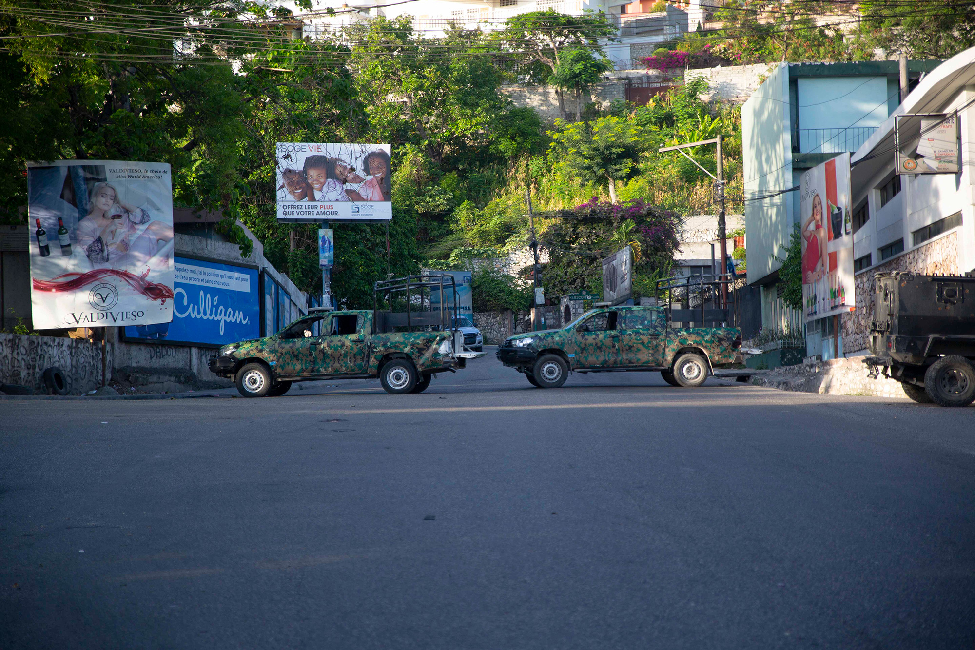 Military vehicles block the entrance to Petion Ville in Port-au-Prince on Wednesday.