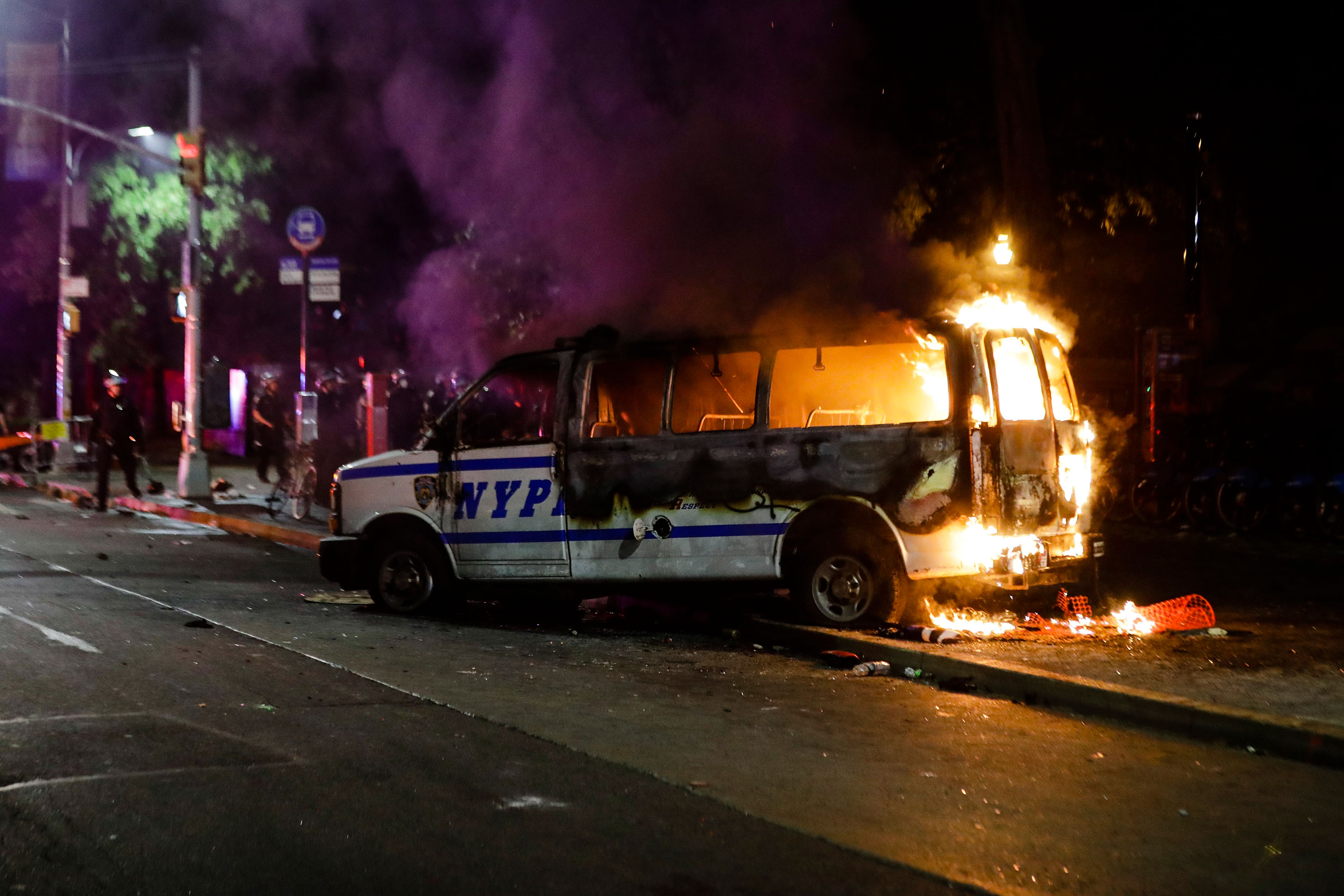A police vehicle burns in Brooklyn on May 29.