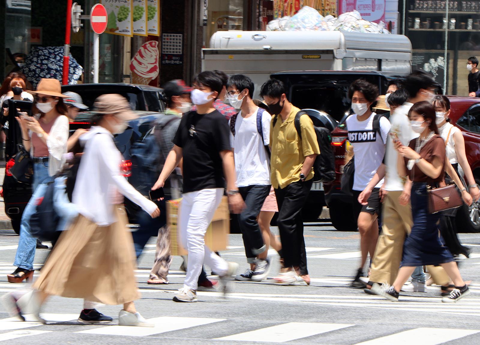 People walk on the Shibuya crossing in Tokyo on July 12.