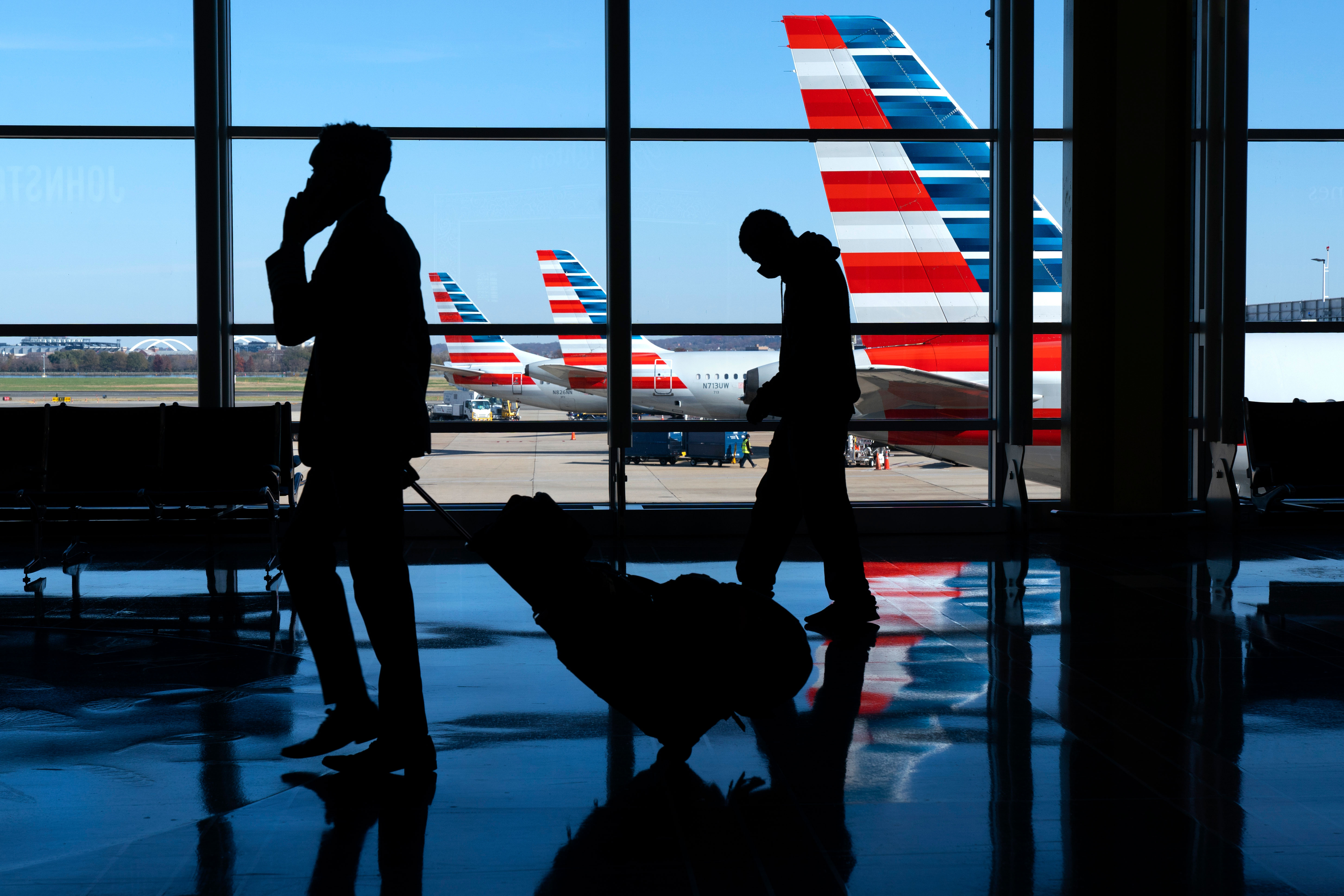Travelers walk at Ronald Reagan Washington National Airport in Arlington, Virginia, on November 24.