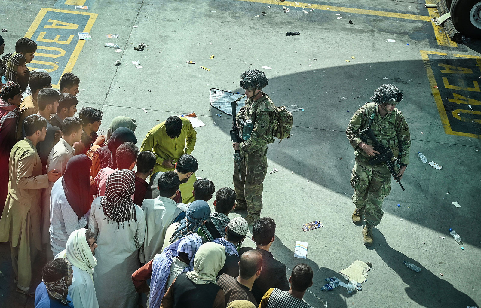 US military troops stand guard at Kabul's airport on August 16.