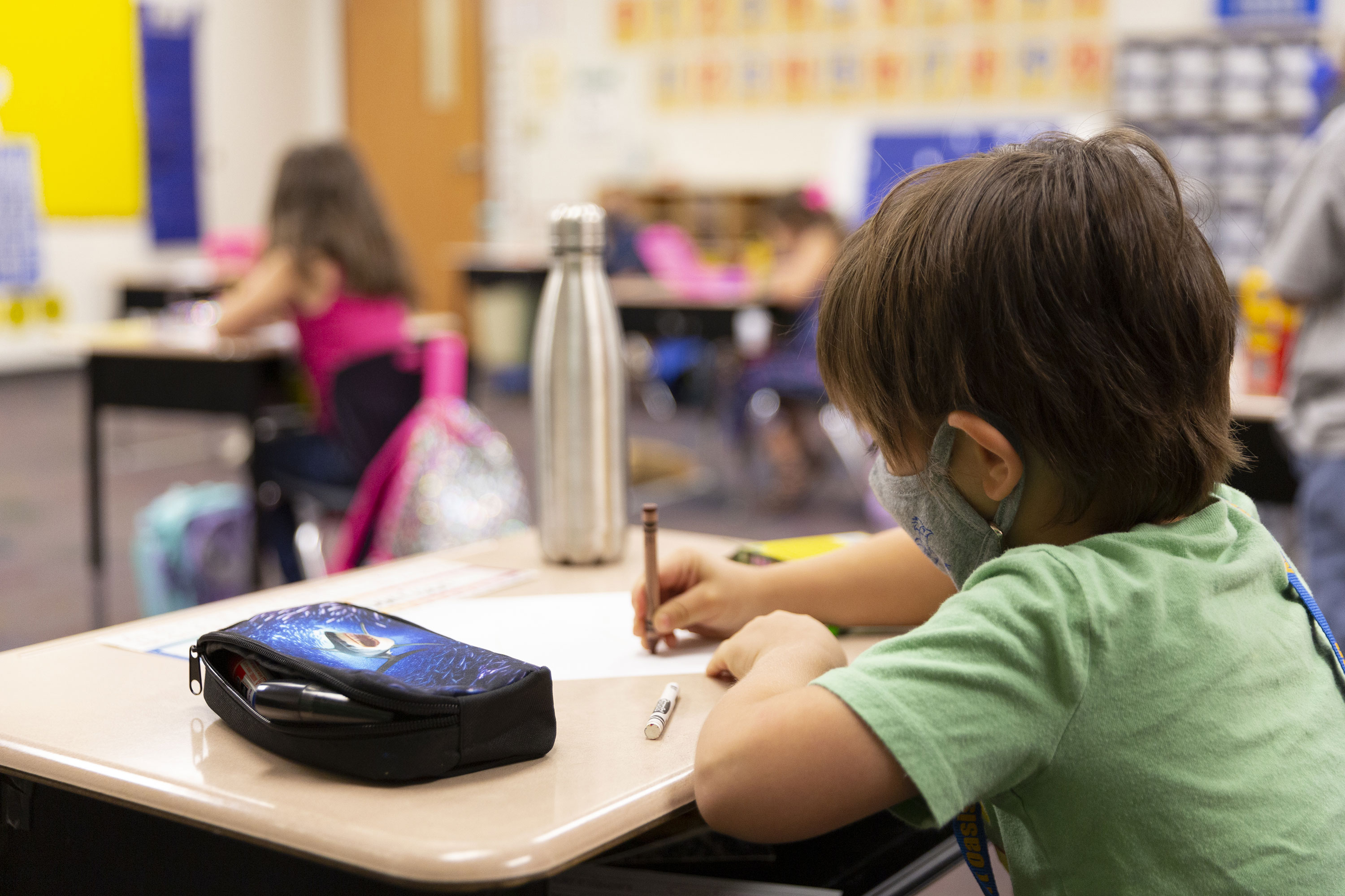 A student wears a face mask during a lesson at an elementary school on August 20 in Surprise, Arizona.