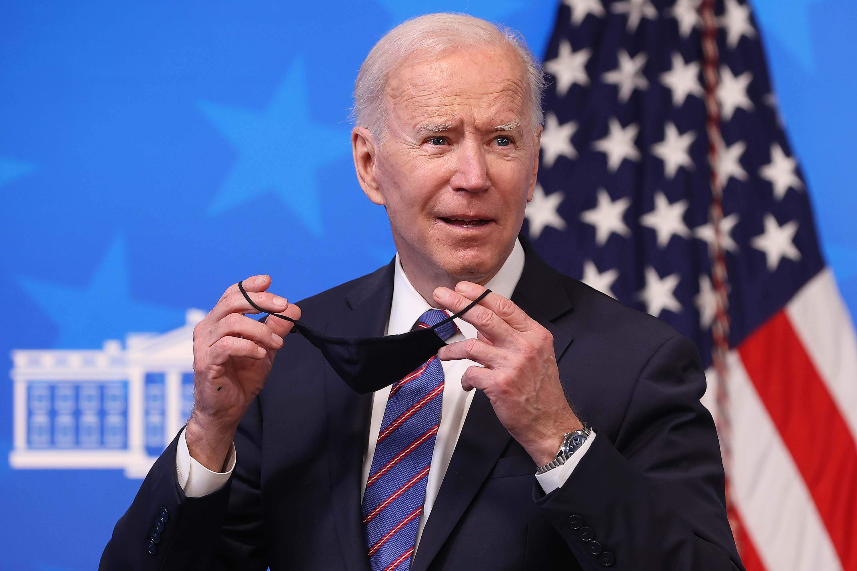 U.S. President Joe Biden replaces his face mask following an event in Washington, DC on March 24.