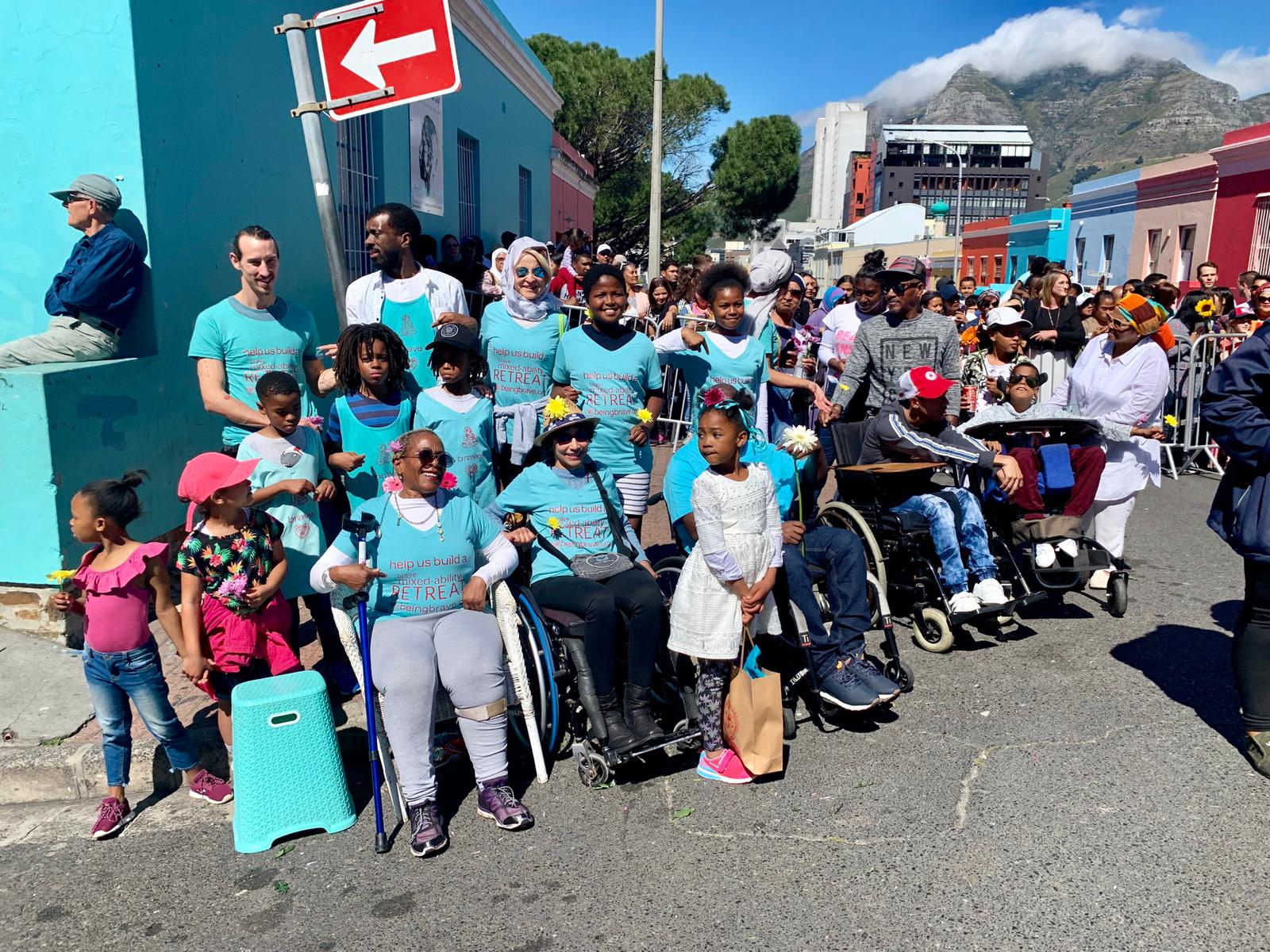 Members of the Brave group wait to meet Prince Harry and Meghan in Cape Town's Bo-Kaap neighborhood.