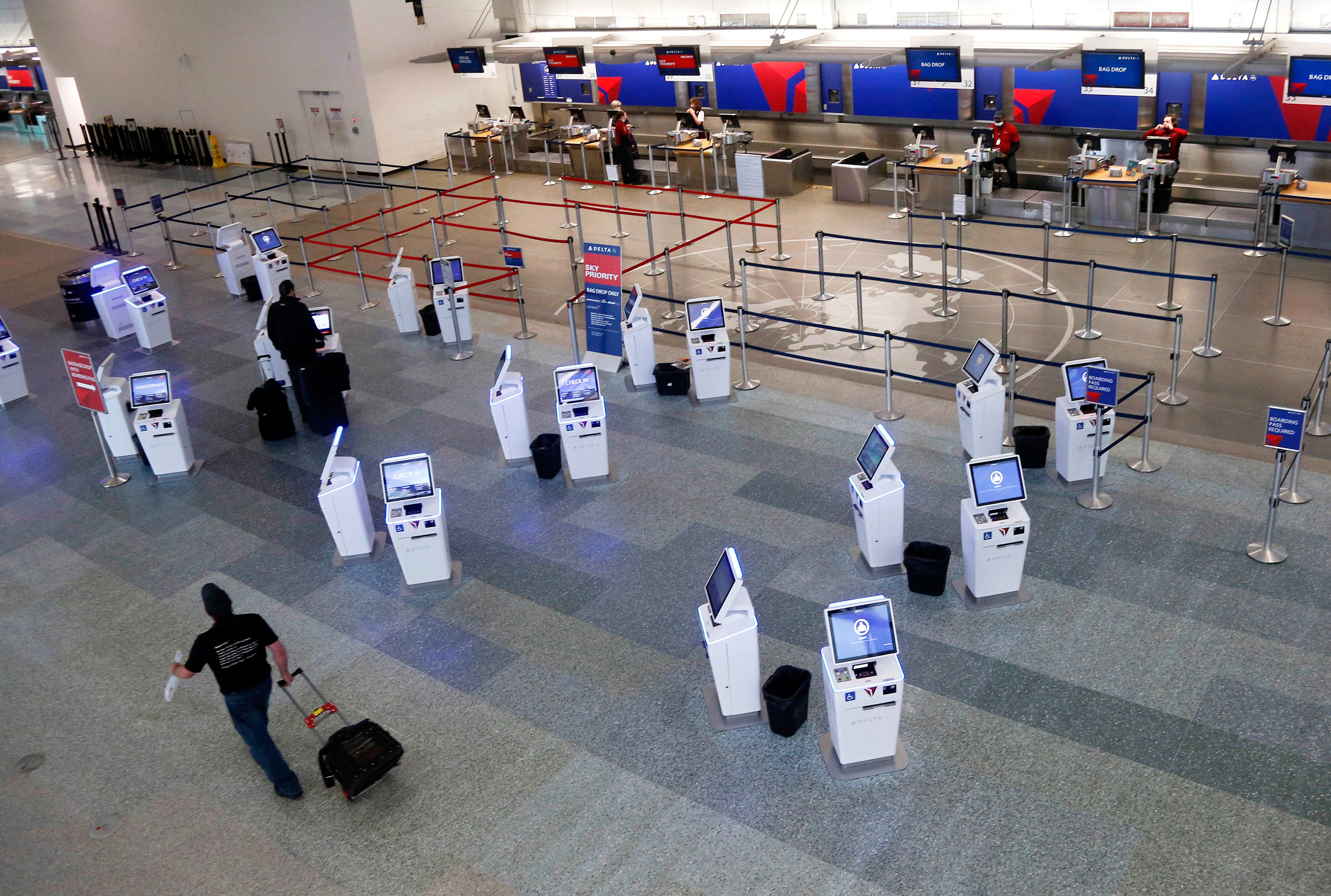 Nearly empty lines are seen at the Delta ticket counters at Minneapolis-St. Paul International Airport on May 4 in Minneapolis, Minnesota.