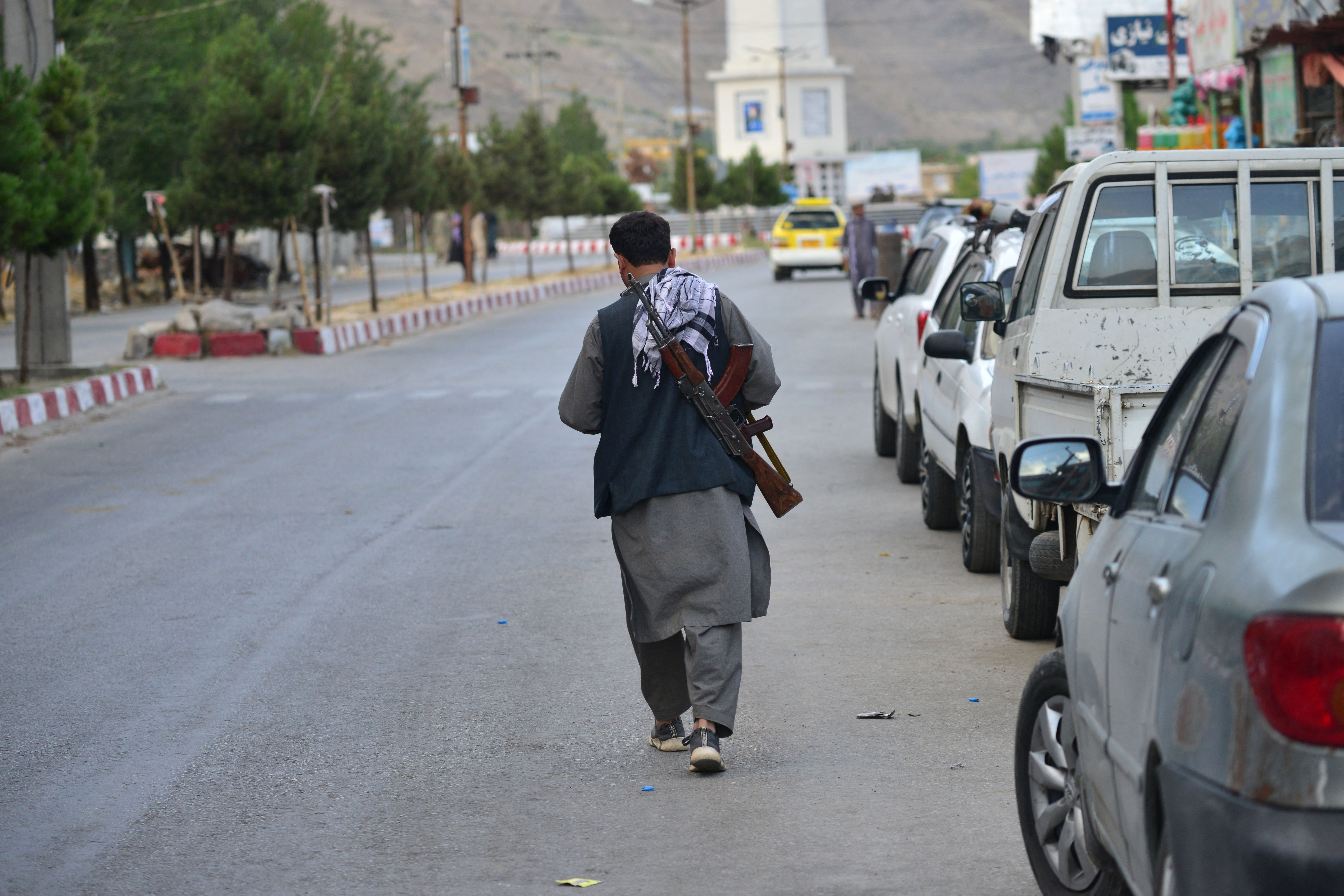 A member of Afghan security force walks through a road in Panjshir province on Sunday.
