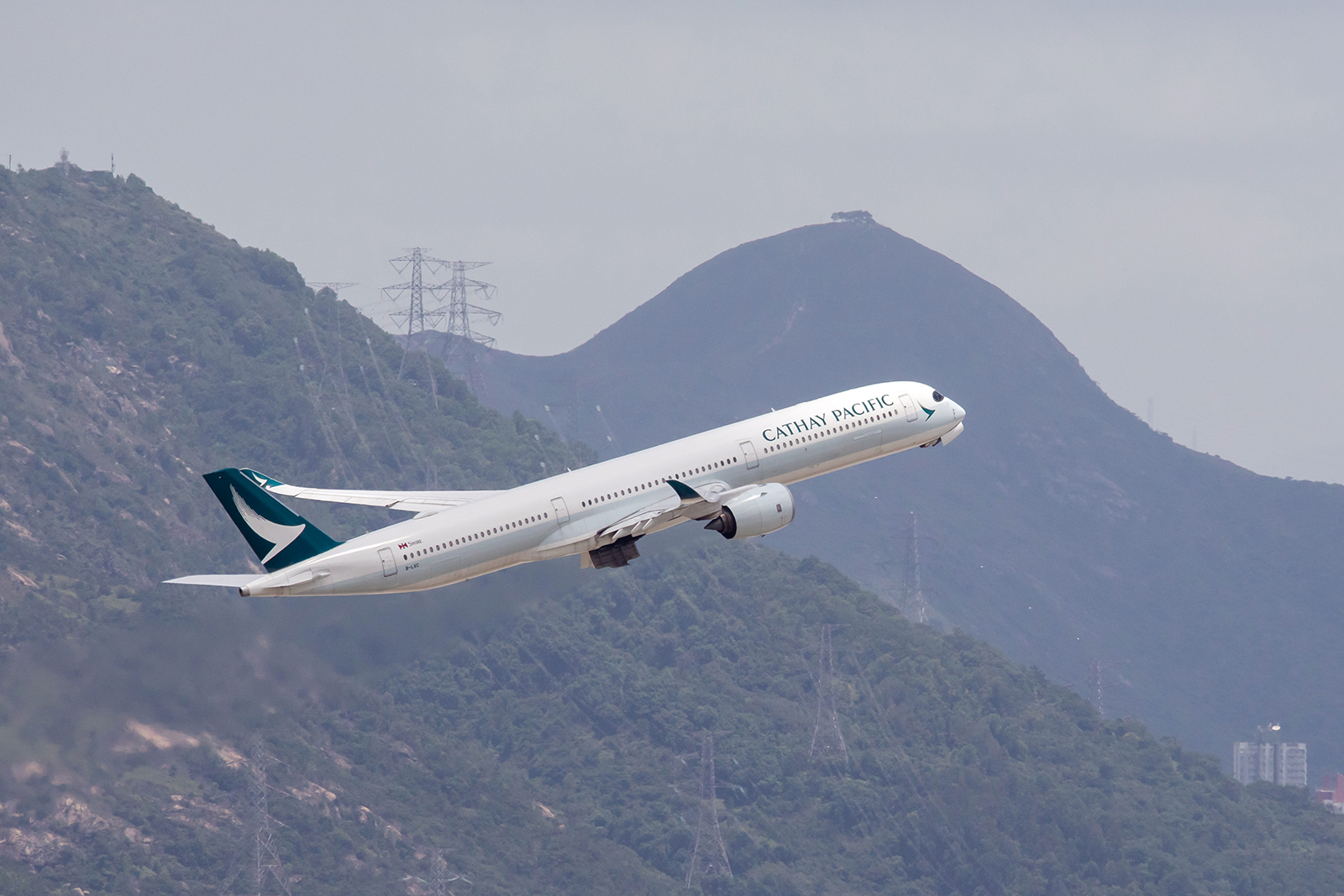 An aircraft operated by Cathay Pacific Airways takes off at Hong Kong International Airport on August 7.