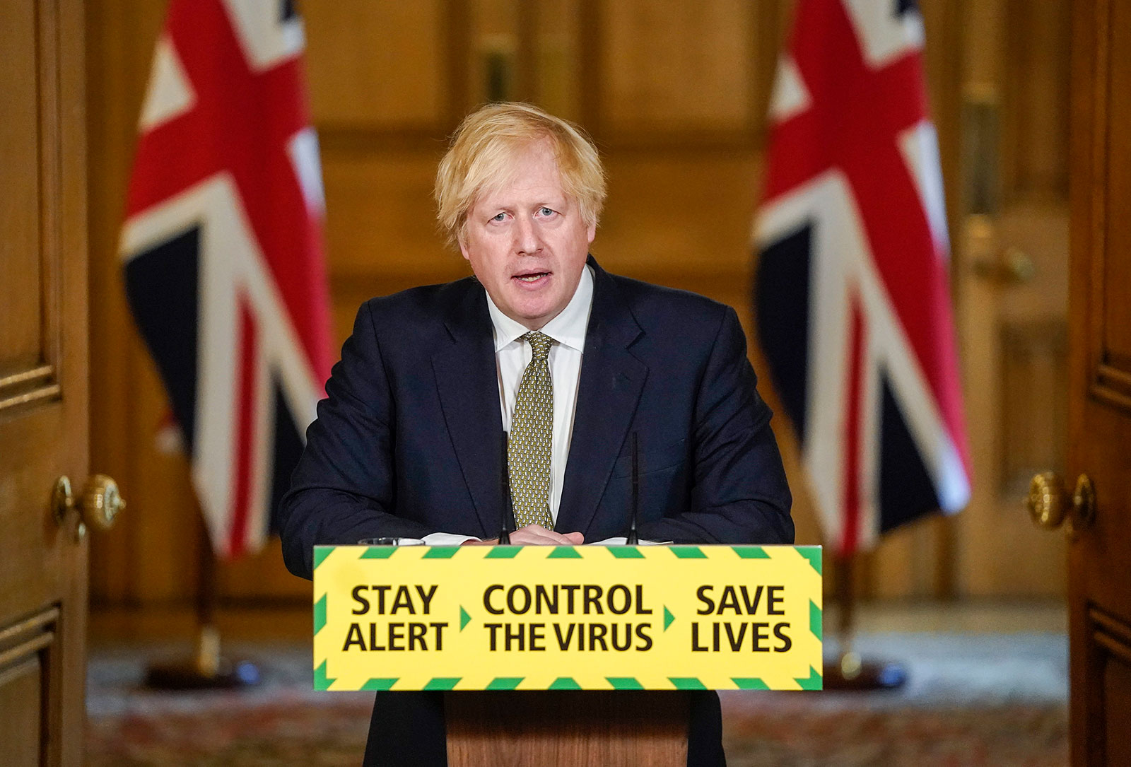 In this photo issued by 10 Downing Street, UK Prime Minister Boris Johnson speaks during a coronavirus news briefing in London on Sunday, May 24.