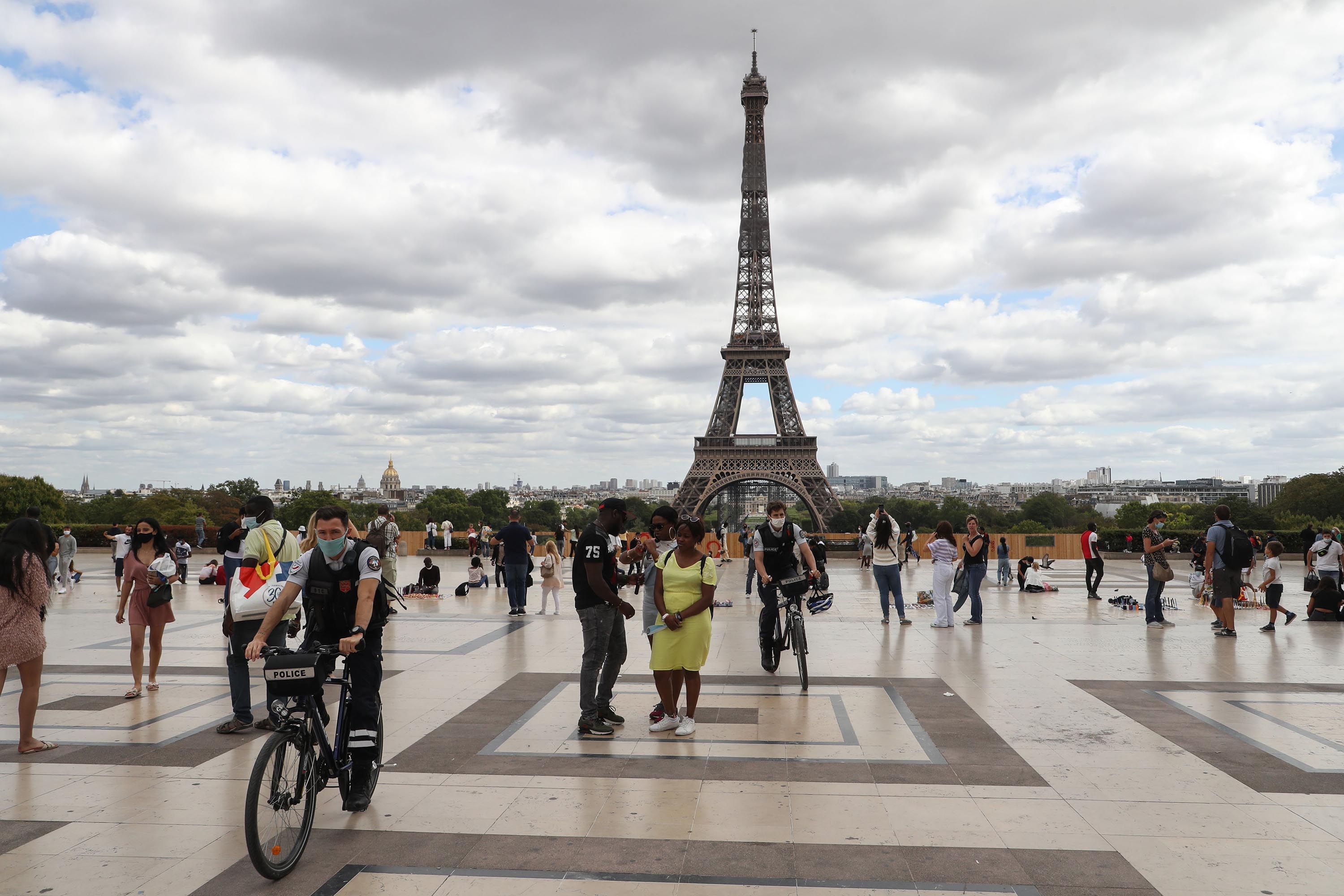 Bicycle police patrol on the Trocadero esplanade, near the Eiffel Tower in Paris, on August 24.
