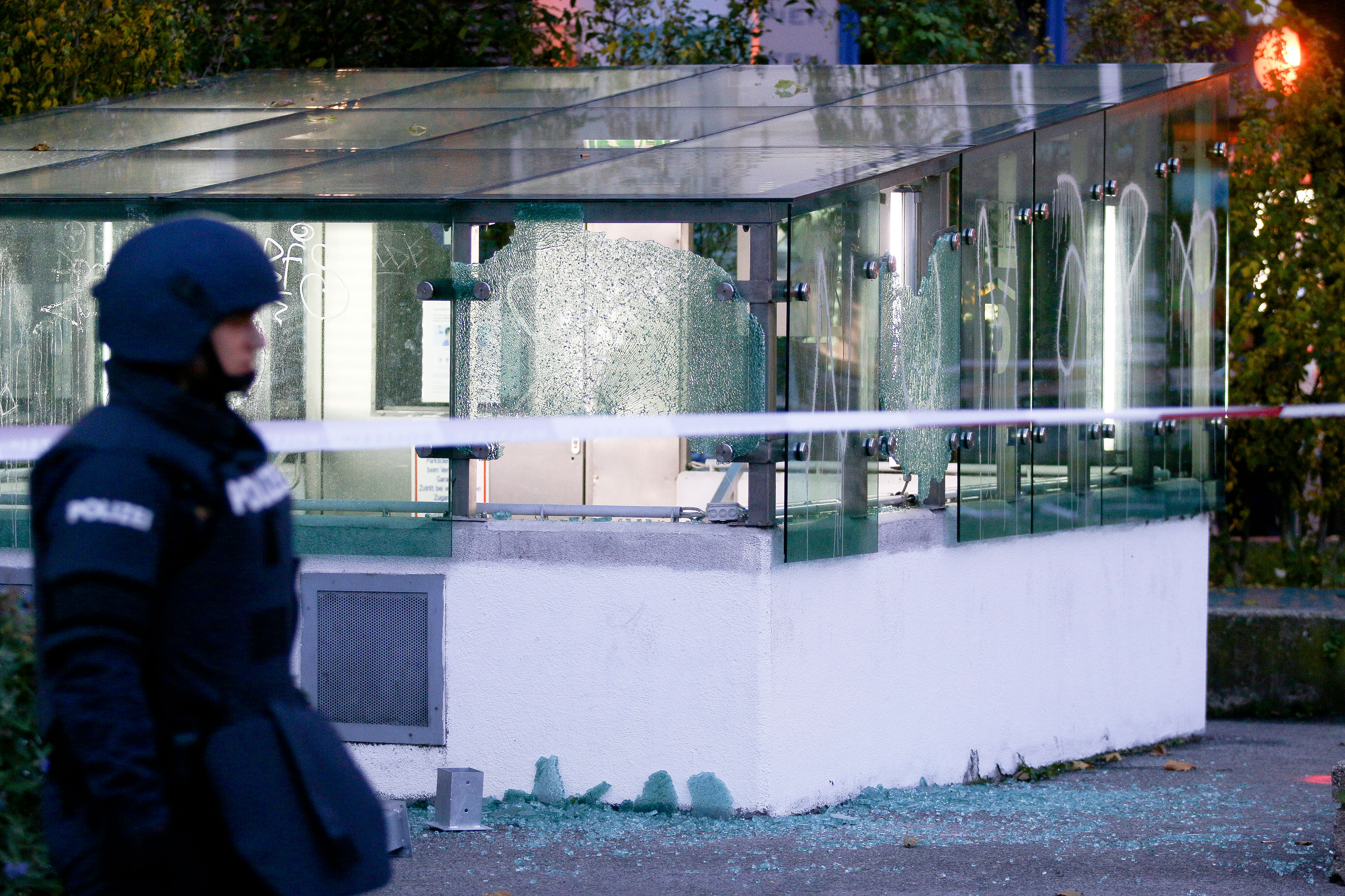 A police officer in Vienna stands near broken glass on November 3.