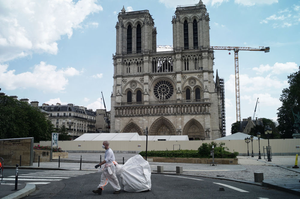 A worker cleans around the Notre Dame Cathedral in Paris on Monday, April 27.